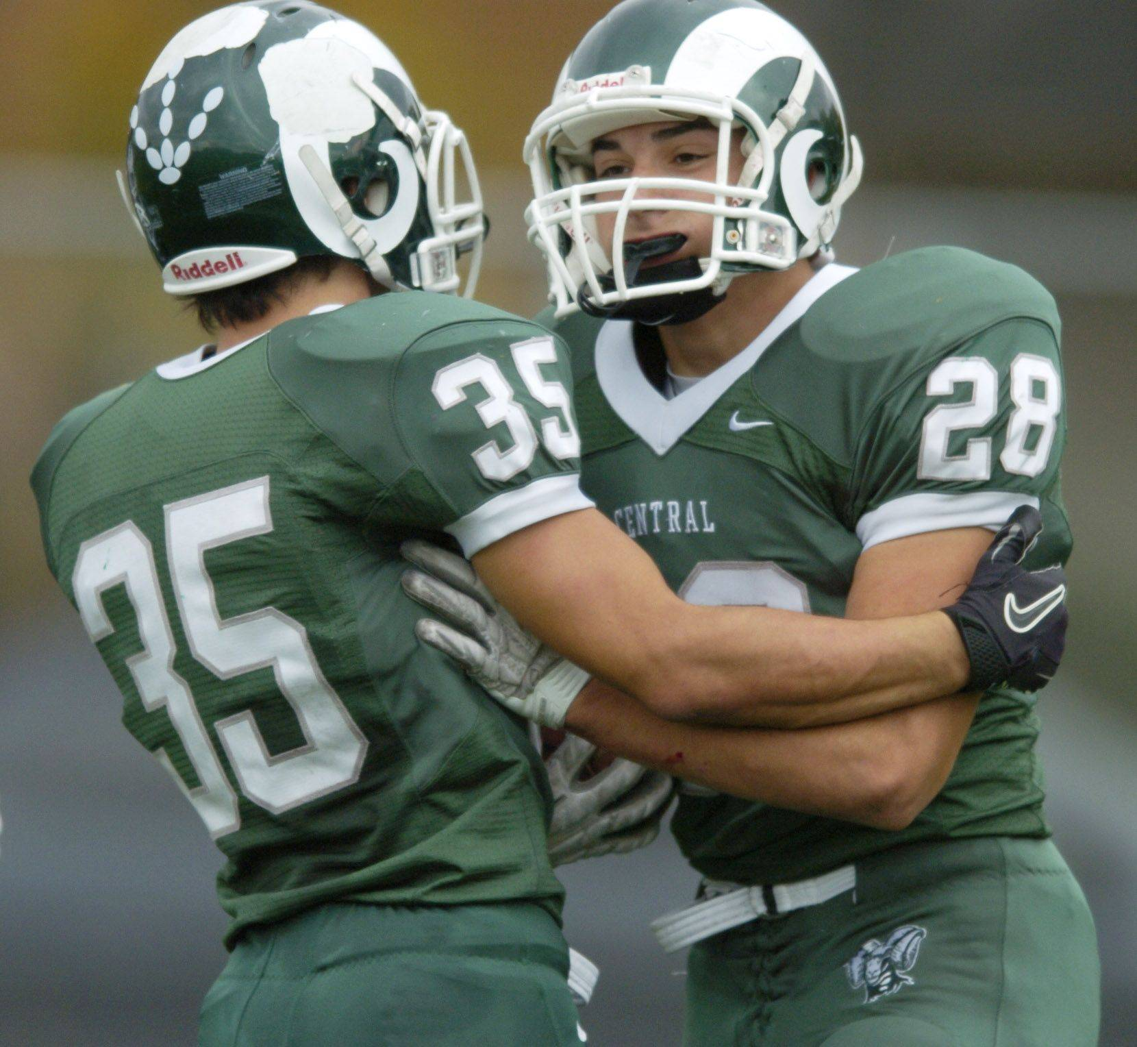 JOE LEWNARD/jlewnard@dailyherald.com Grayslake Central's Joel Valdivia, right, celebrates his first-quarter touchdown with teammate Vinnie Culhane.