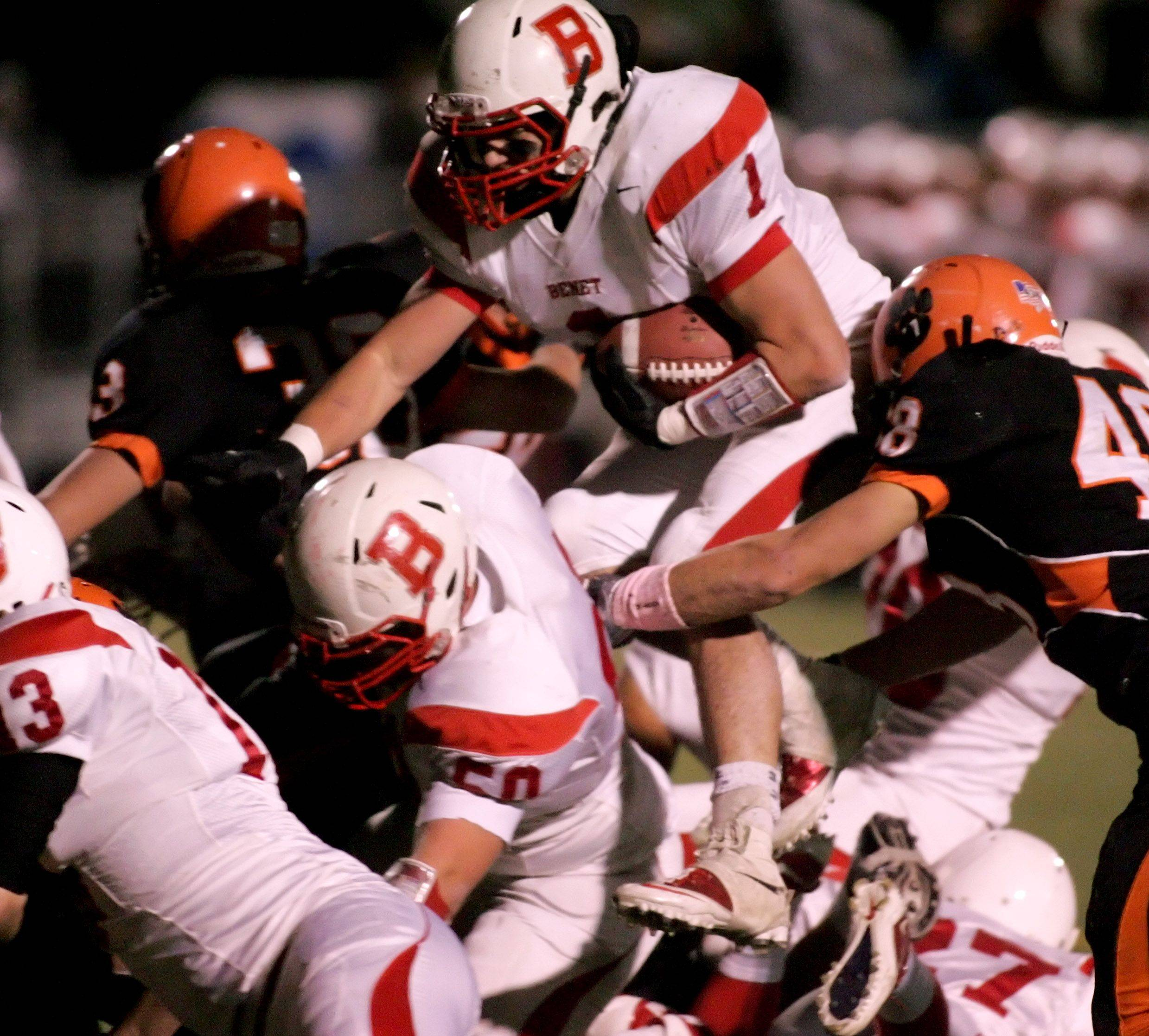 Pat Boyle of Benet, moves the ball closer to the endzone in action against Wheaton Warrenville South during playoff football Friday in Wheaton.