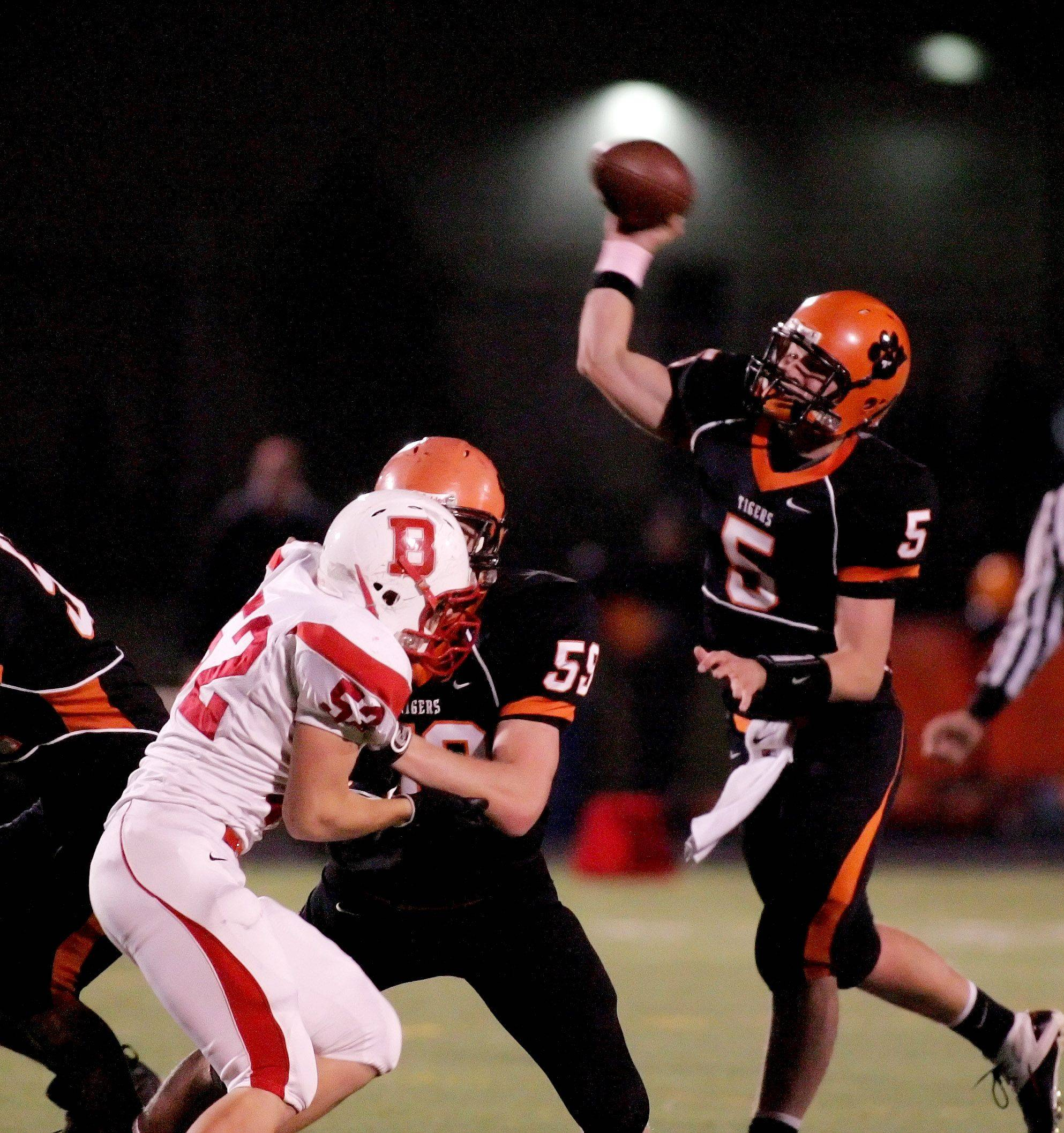 Wheaton Warrenville South quarterback Reilly O'Toole makes a pass against Benet during playoff football Friday in Wheaton.