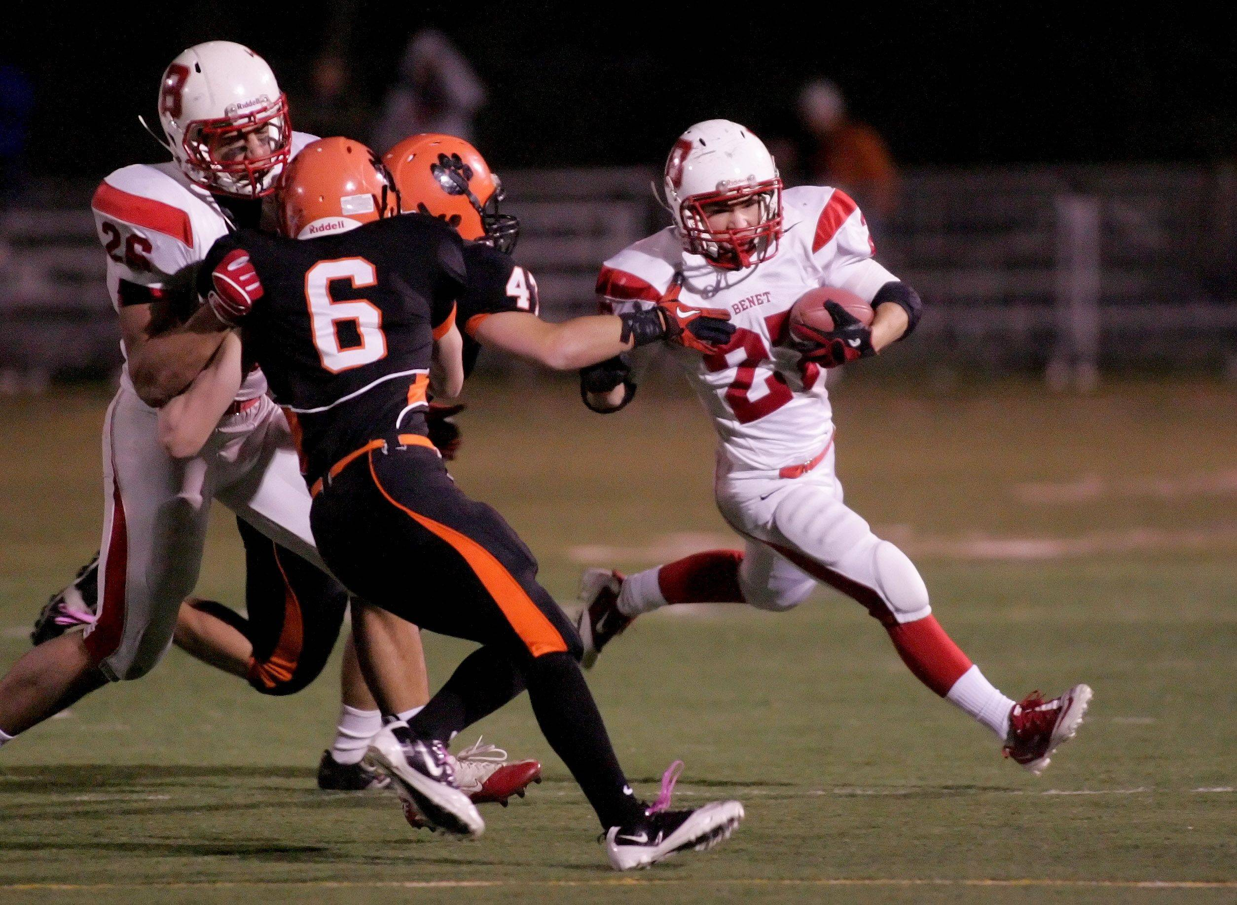 E.J. Howe, right of Benet, in action against Wheaton Warrenville South during playoff football Friday in Wheaton.