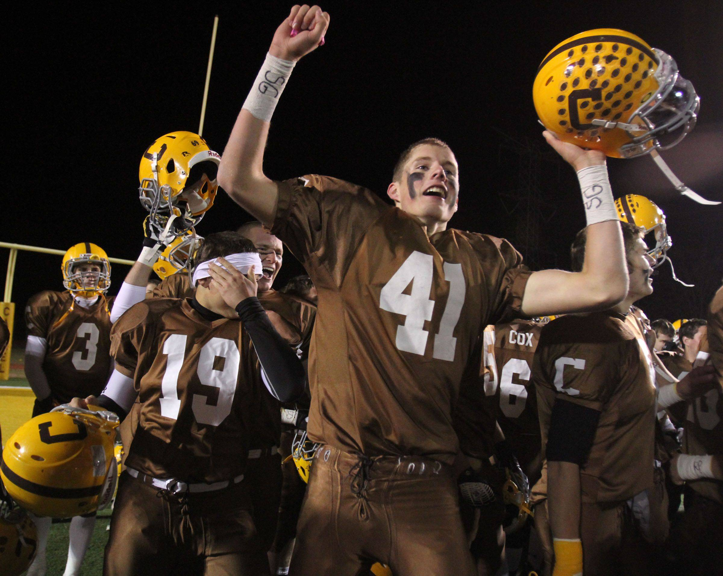 Carmel's Michael Fitzgibbons celebrates winning 55-7 over Elgin in round one of Class 7A state playoffs at Carmel in Mundelein on Friday, October 29.