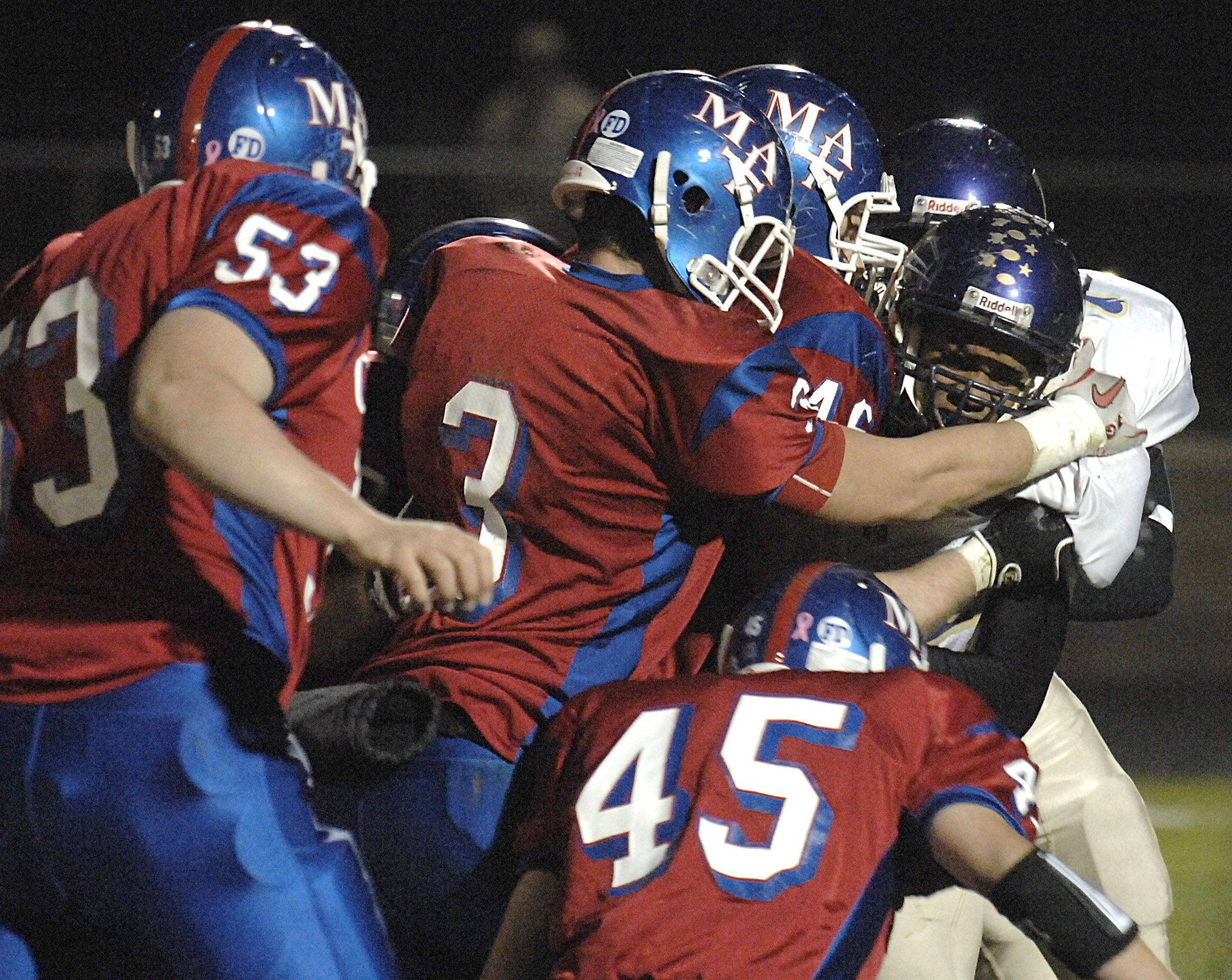 Marmion's Nick Scoliere and T.J. Lally sack Thorton Fractional North quarterback Calvin Lindsey as he attempts a run in the second quarter on Friday, October 29.