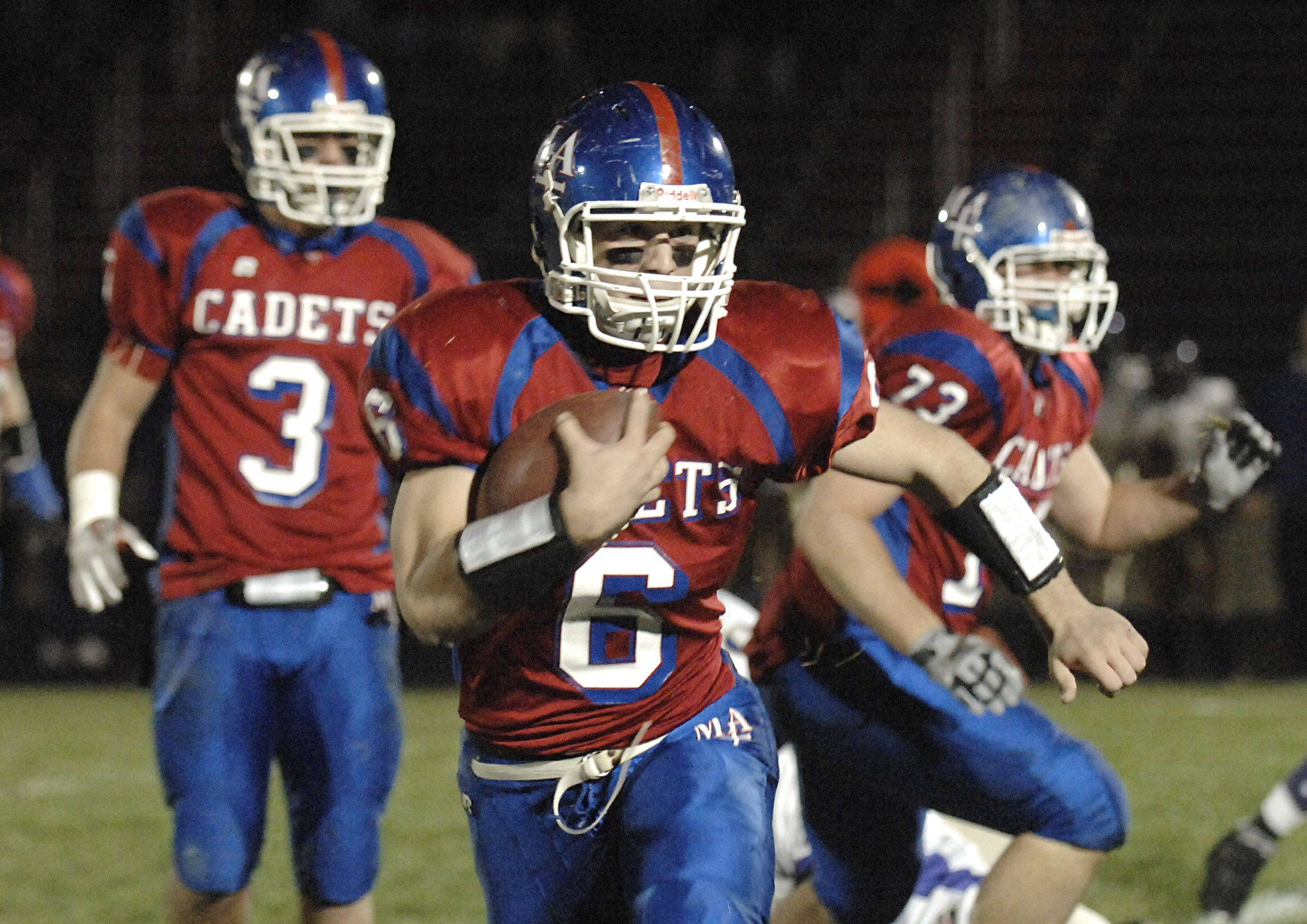 Marmion's Mike Carbonara takes off after receiving the ball in the first quarter vs Thorton Fractional North on Friday, October 29.