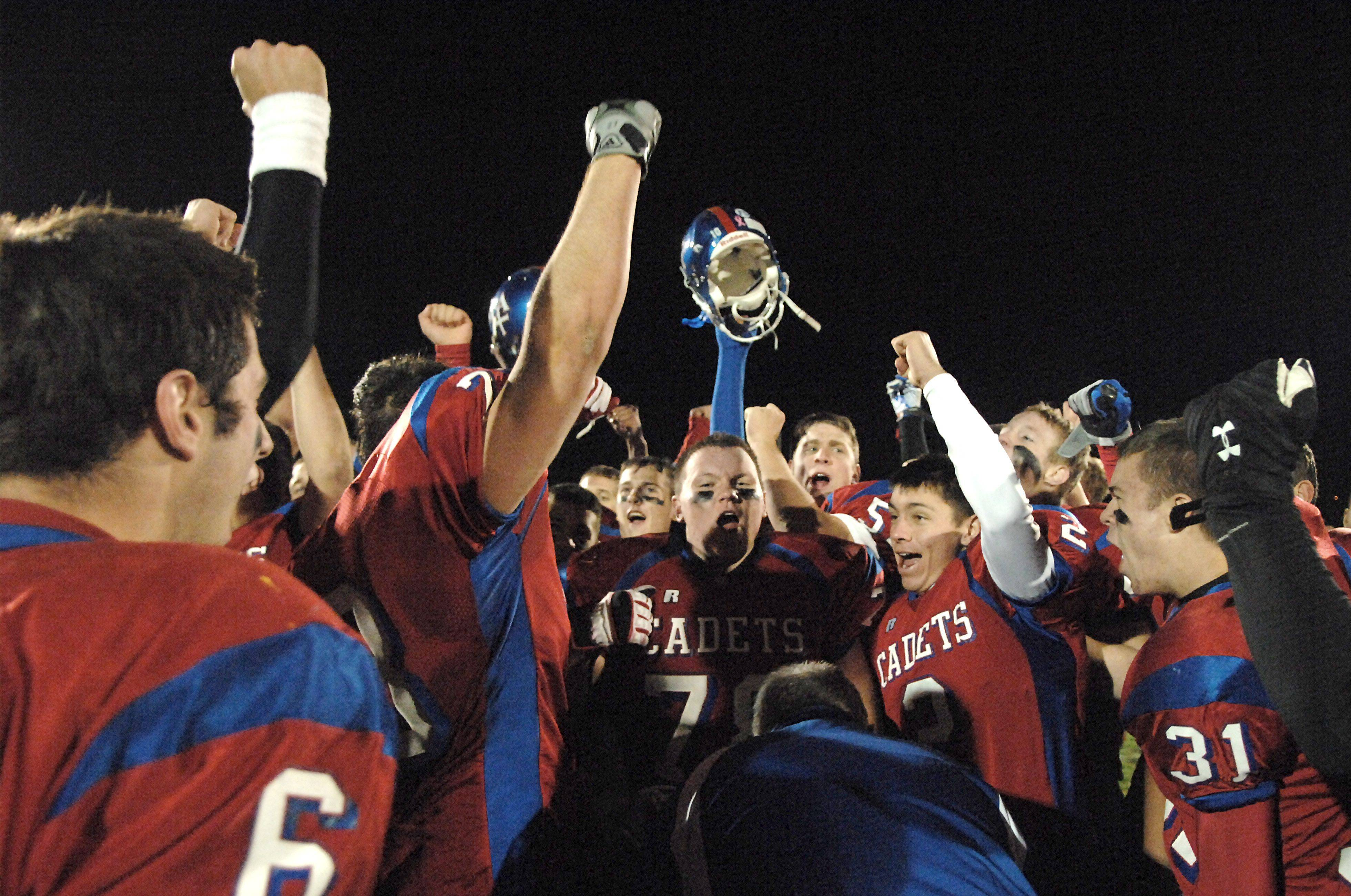 Marmion celebrates their playoff win over Thorton Fractional North on Friday, October 29.