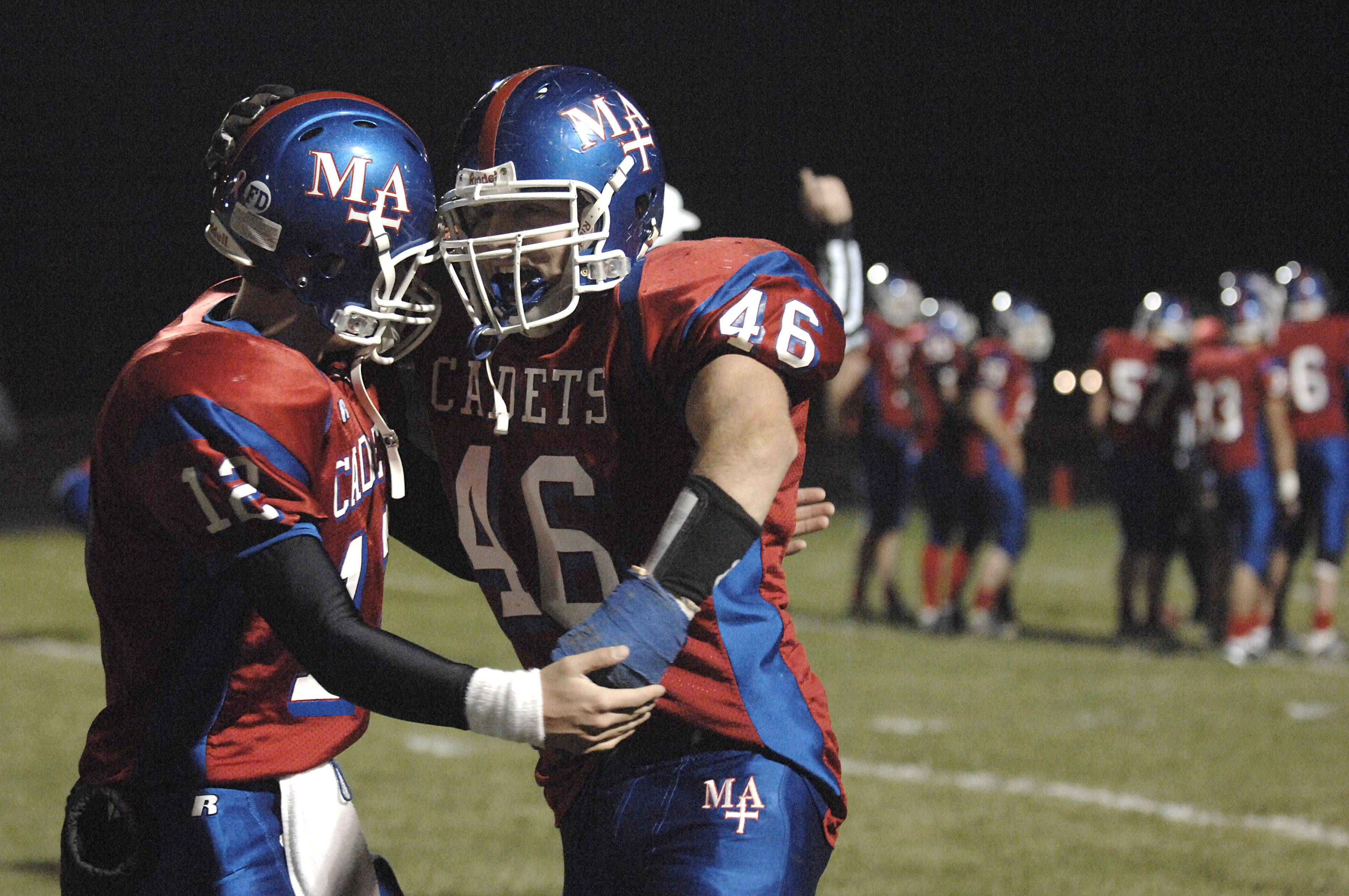 Marmion quarterback Bobby Peters congratulates T.J. Lally after his completed pass scored a touchdown in the second quarter bringing the score to 23-0 vs Thorton Fractional North on Friday, October 29.