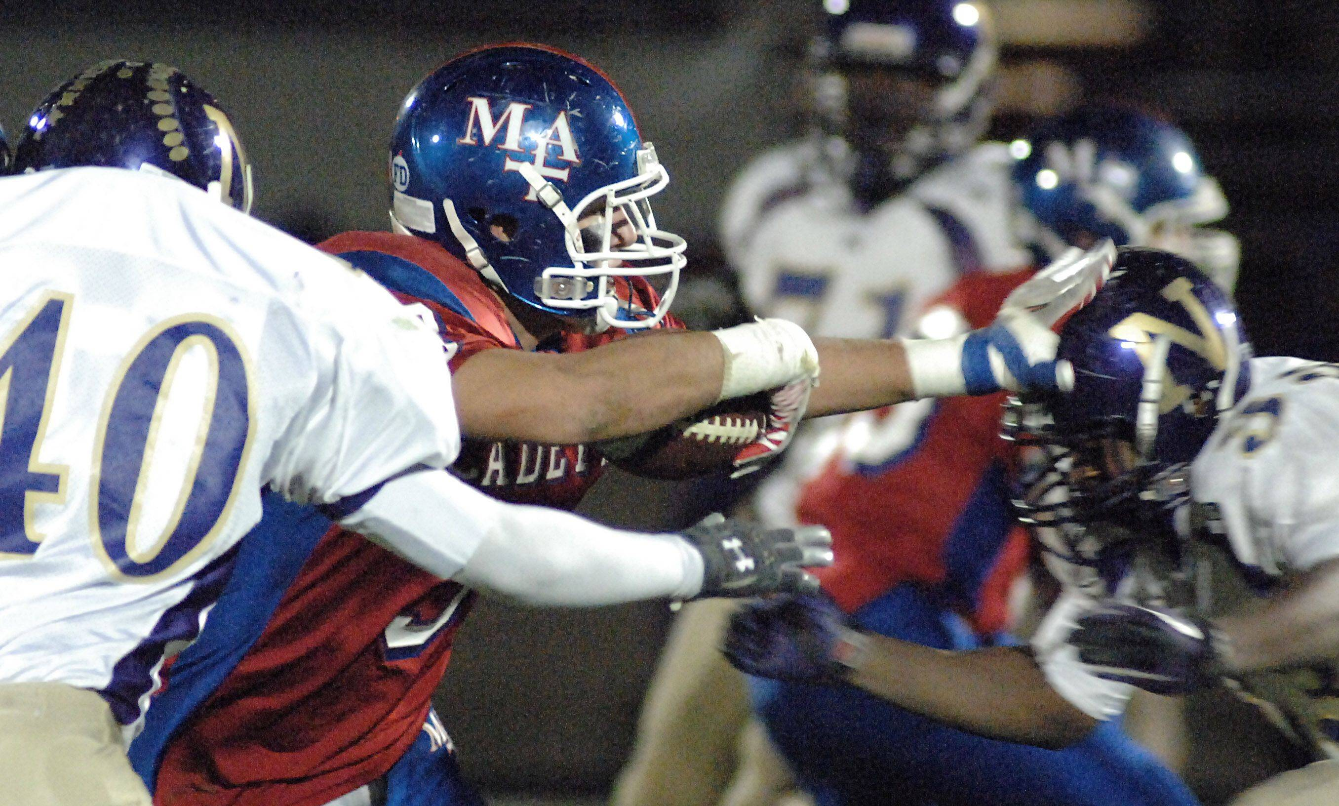 Marmion's Nick Scoliere strongarms Thorton Fractional North's Delon Perry in the second quarter on Friday, October 29.