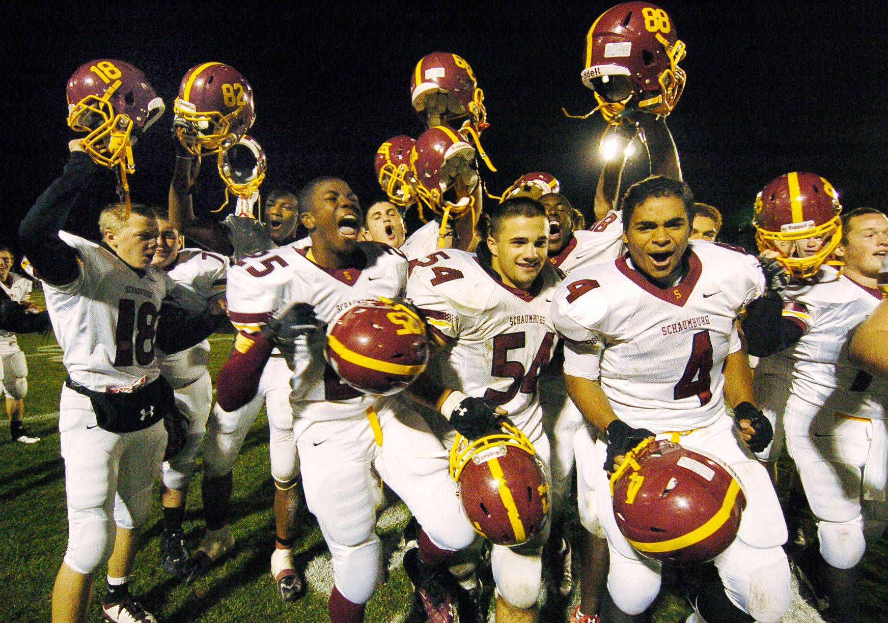 The Schaumburg Saxons celebrate after beating the Elk Grove Grenadiers in first-round playoff football.