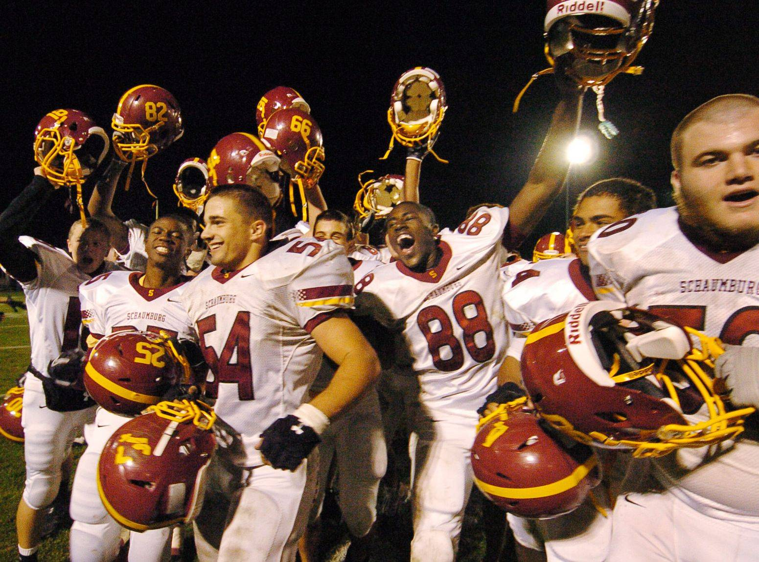 Schaumburg celebrates after defeating Elk Grove in first-round playoff football.Bob Chwedyk/bchwedyk@dailyherald.com Playoffs - Round One - Photos from the Elk Grove vs Schaumburg game on Saturday, October 30th in Elk Grove.