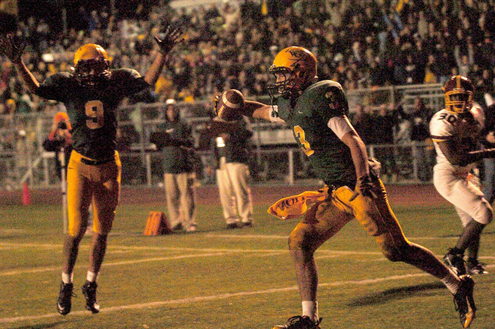 Elk Grove's Joey Bishoff celebrates a touchdown against Schaumburg.