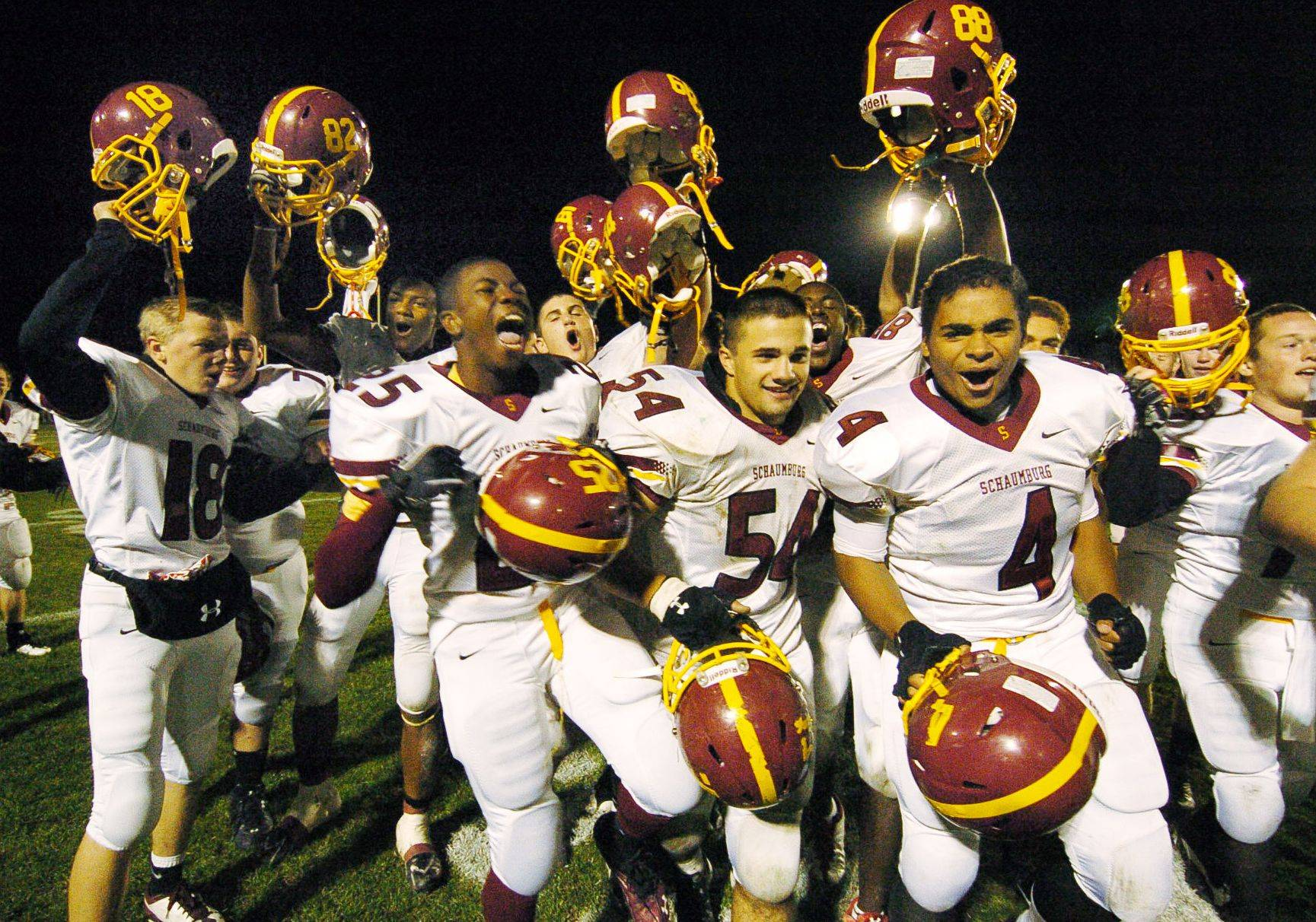 The Schaumburg Saxons celebrate after beating the Elk Grove Grenadiers in first-round playoff football.Bob Chwedyk/bchwedyk@dailyherald.com Playoffs - Round One - Photos from the Elk Grove vs Schaumburg game on Saturday, October 30th in Elk Grove.