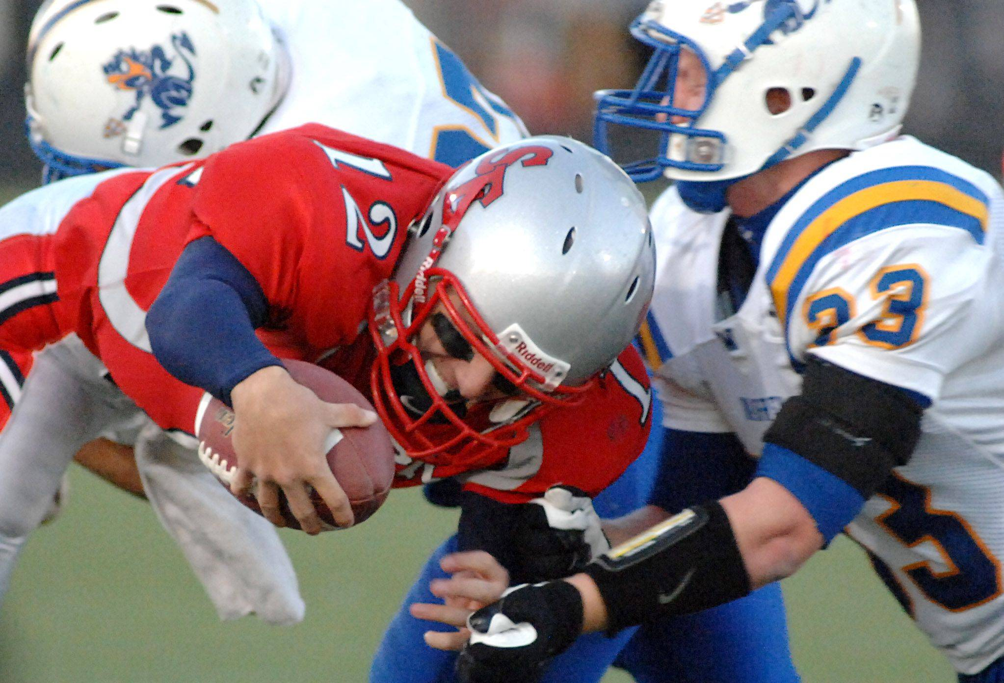 South Elgin's John Menken is sacked in the third quarter.