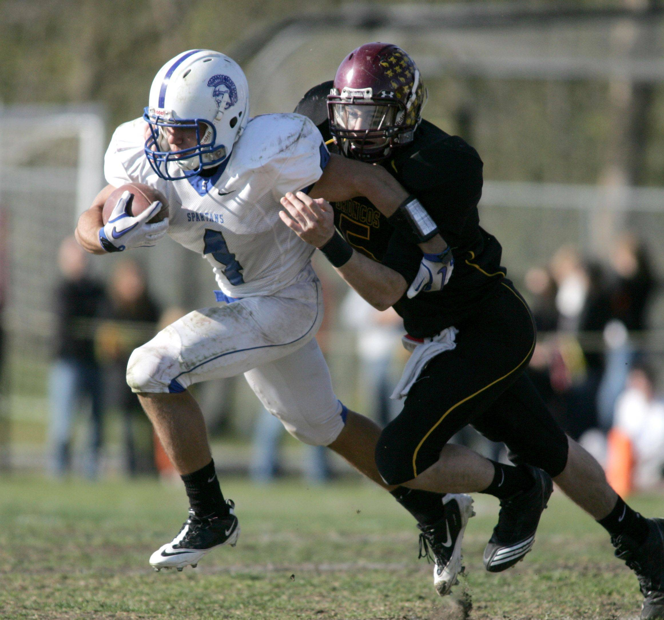 Ben Trimble of St. Francis, left, moves with the ball.