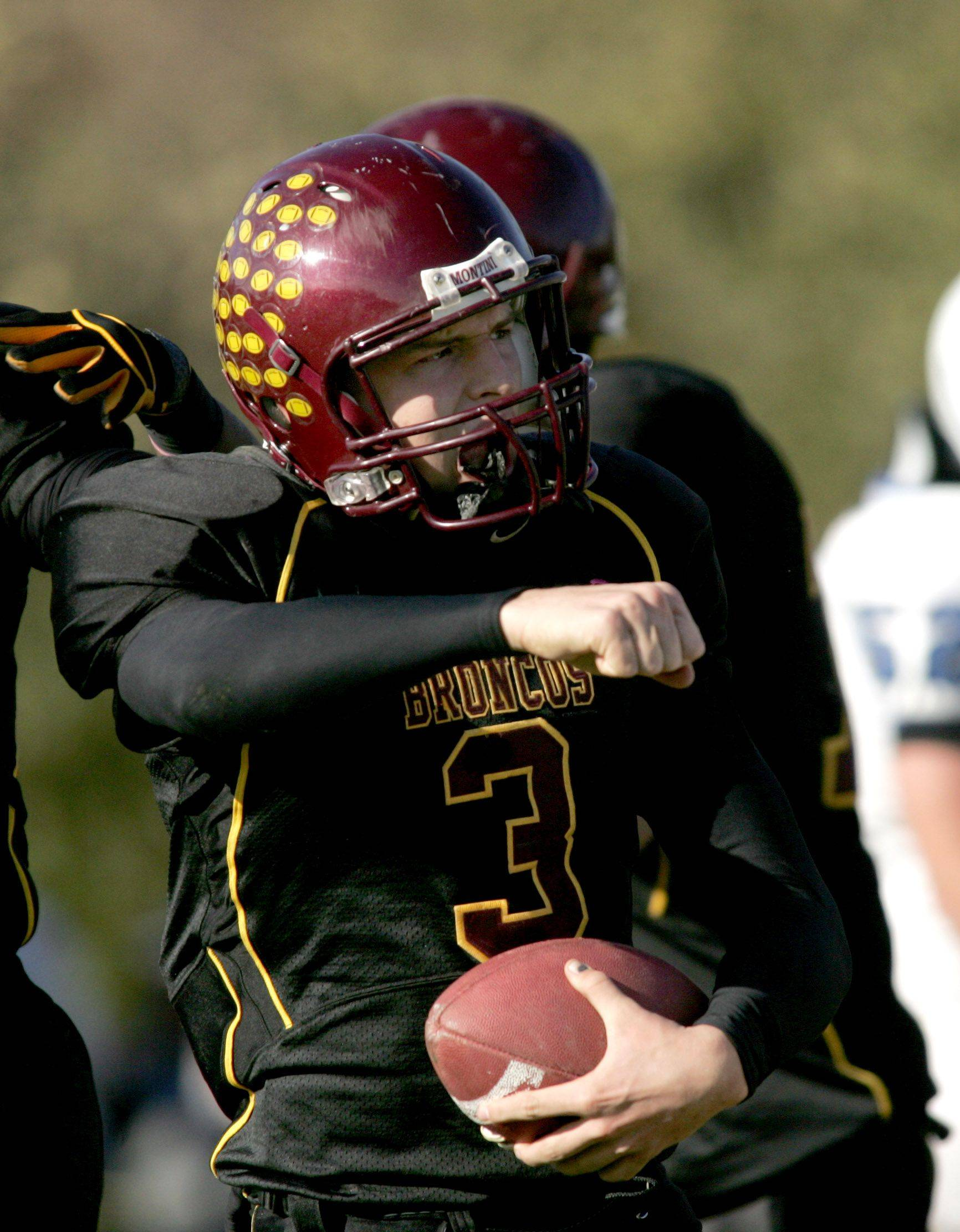 Montini quarterback Matt Westerkamp reacts after making a touchdown in the second quarter .