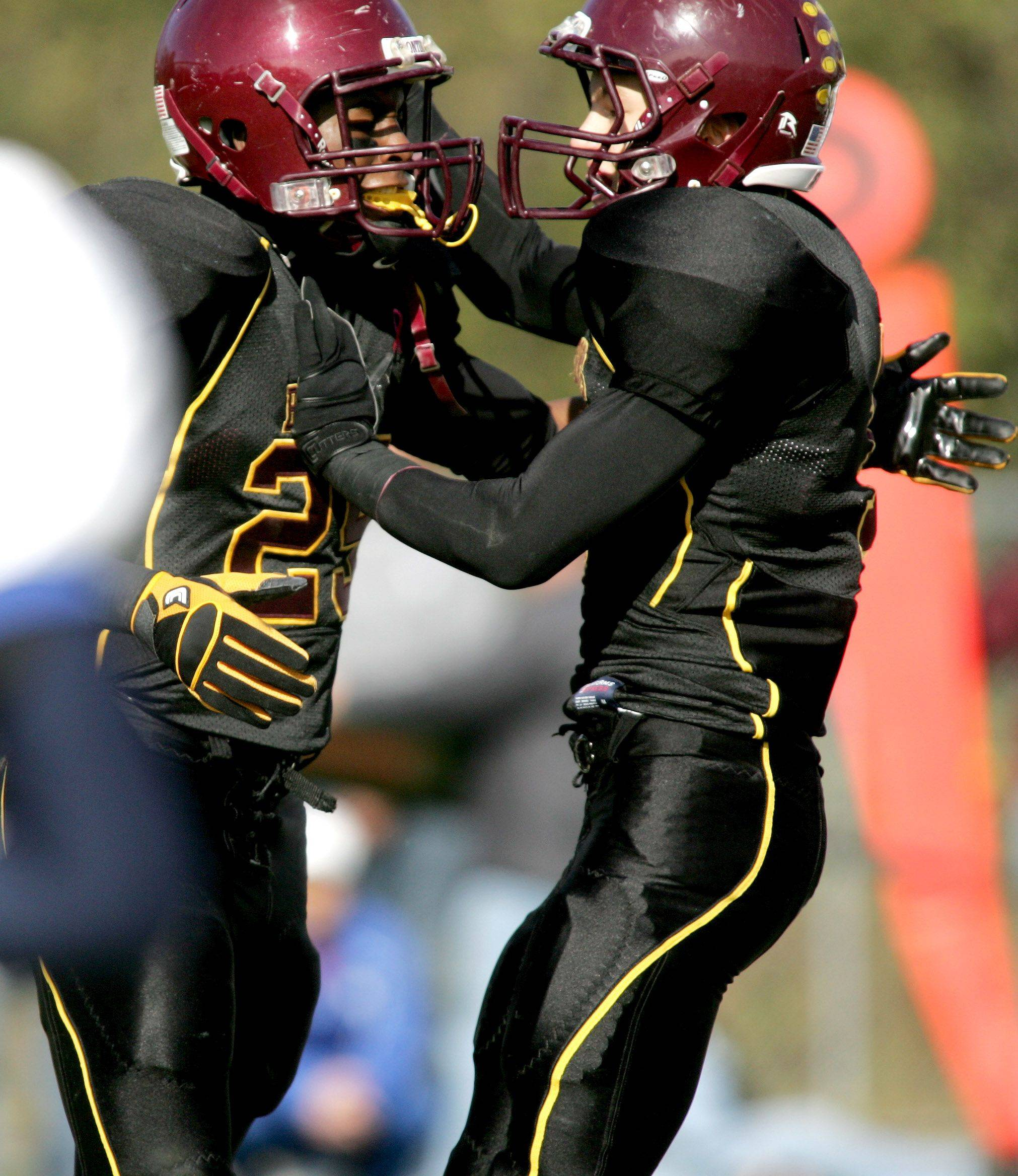 Anthony Taylor, left and Joseph Borsellino, right of Montini celebrate a touchdown .