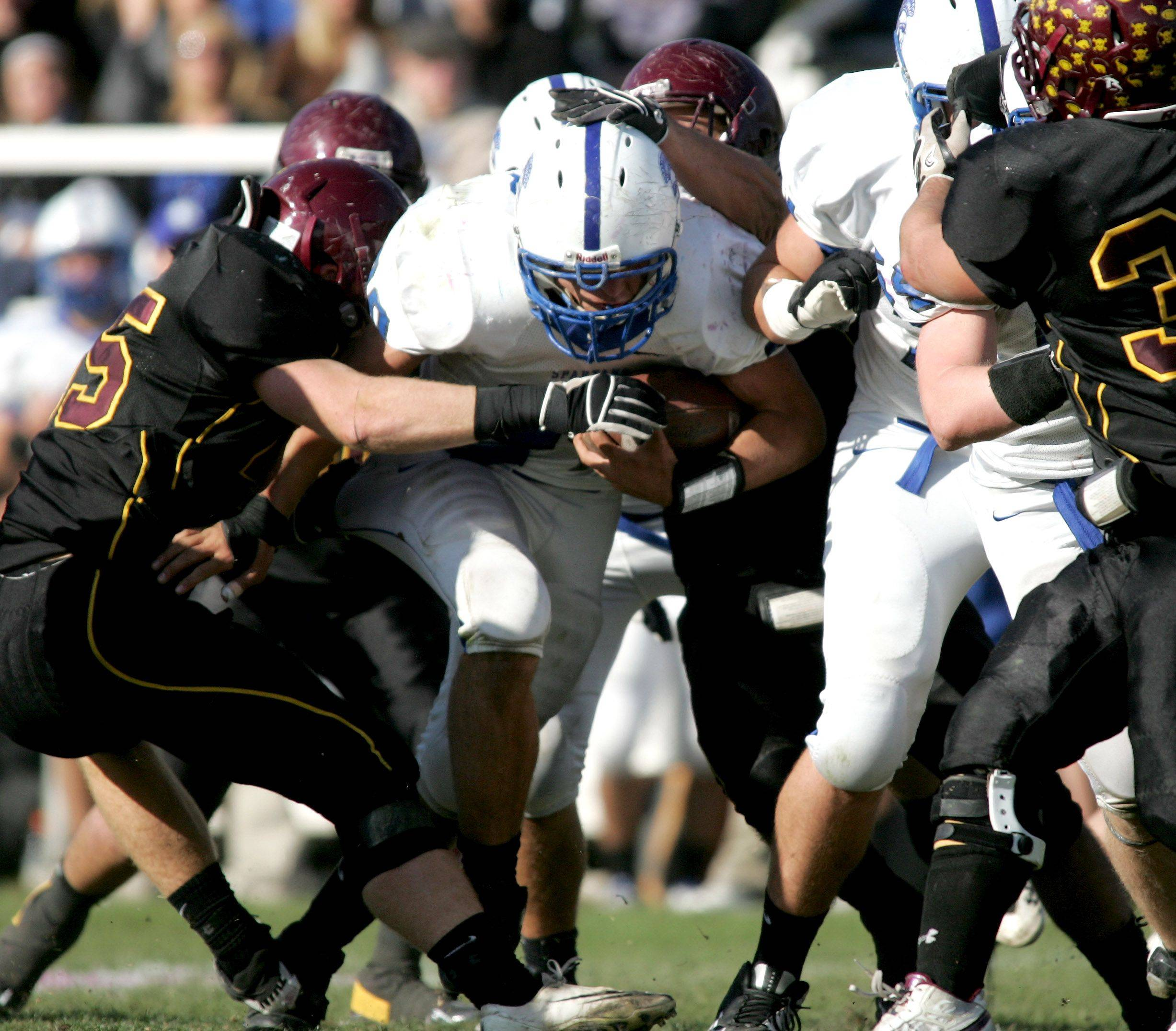 Bob MIller of St. Francis tries to move through Montini's defense .