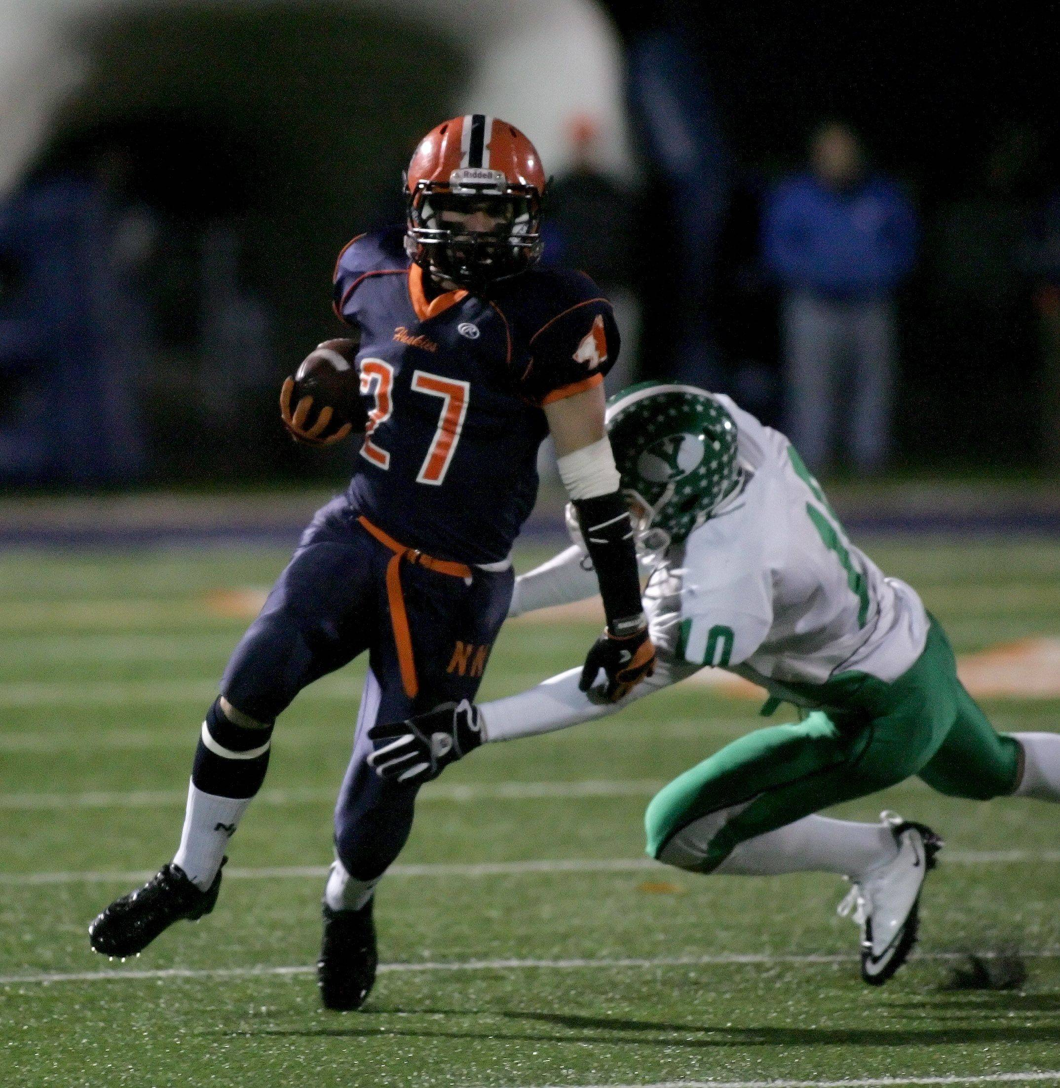 Alex Alicea of Naperville North, left, gets by Peter Kuchan of York.
