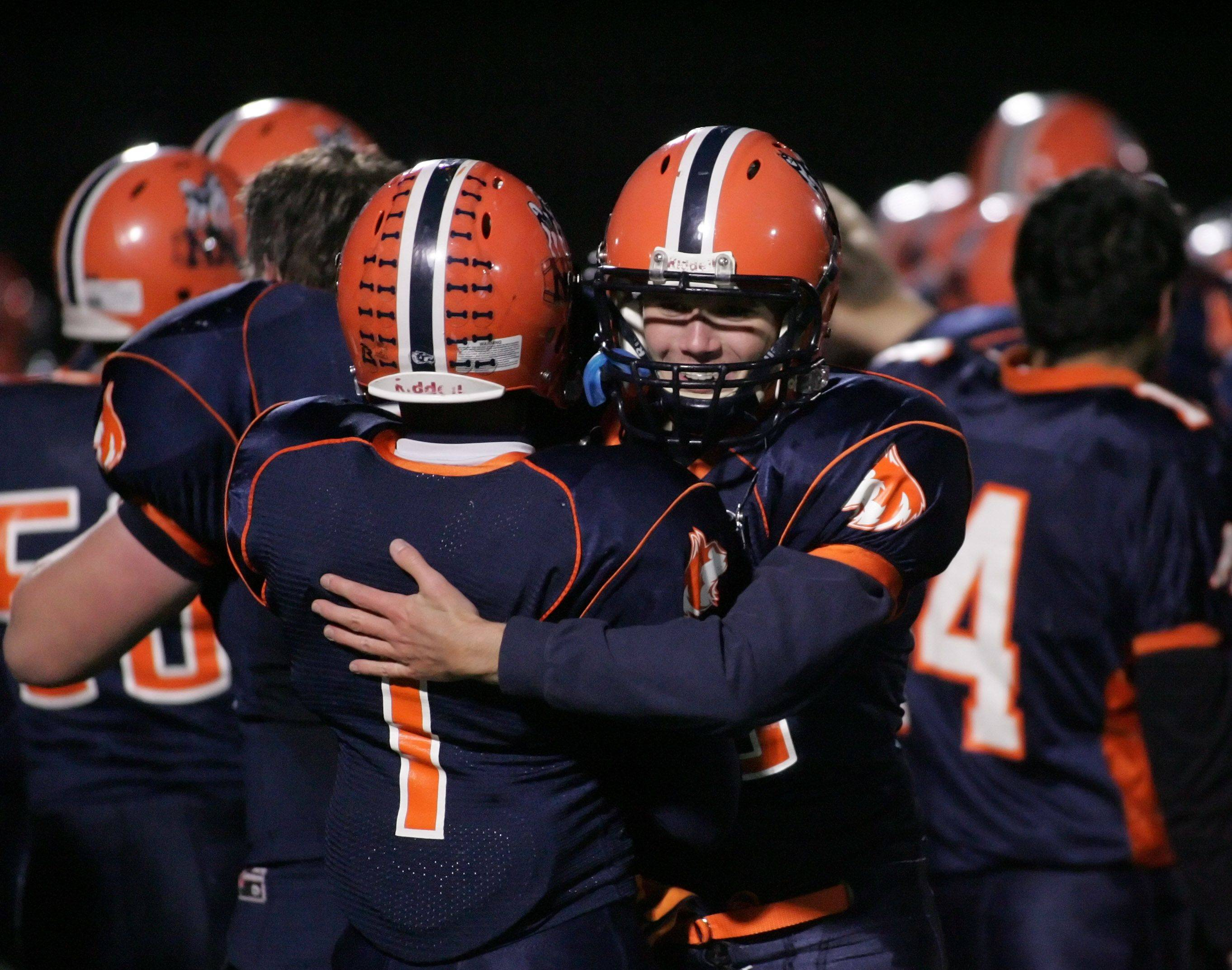 Naperville North players celebrate their win over York .