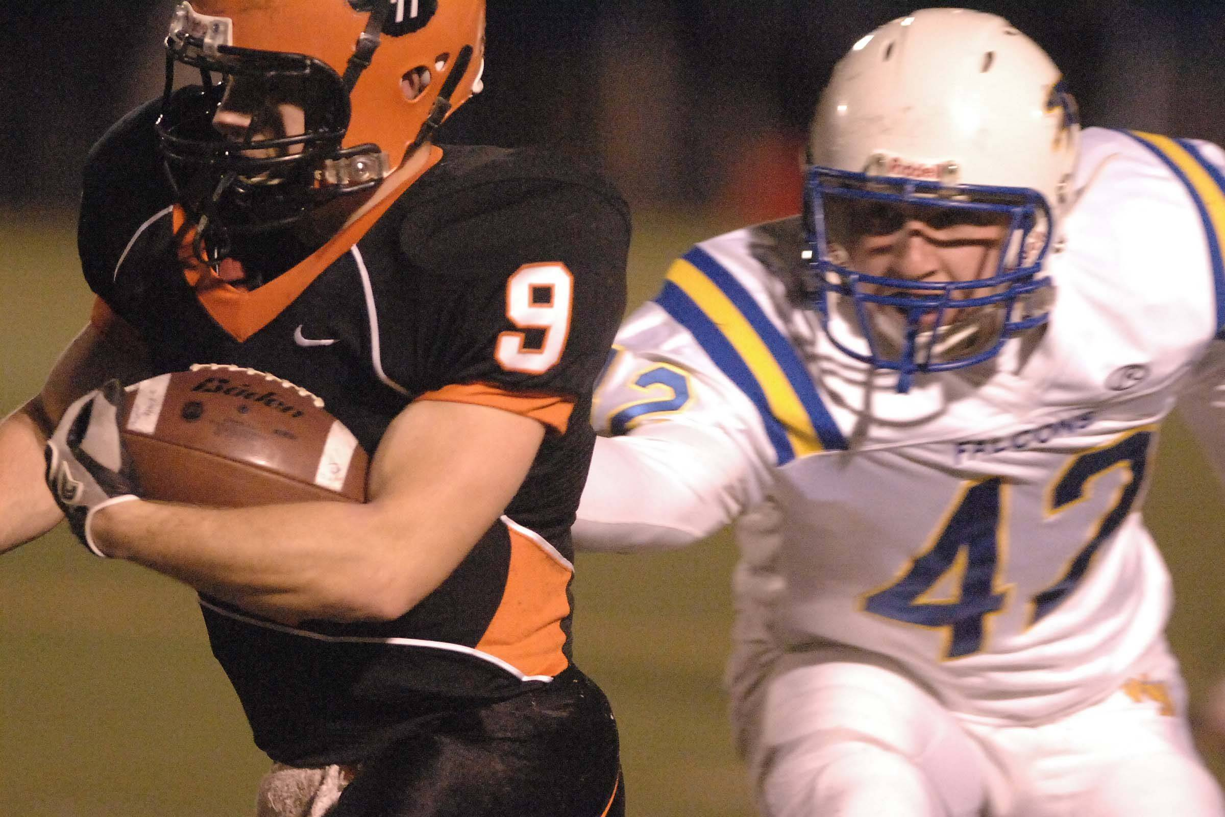 Matt Rogers,left, of Wheaton Warrenville South is chased down by John Murphy of Wheaton North during the Wheaton North at Wheaton Warrenville South game Saturday.