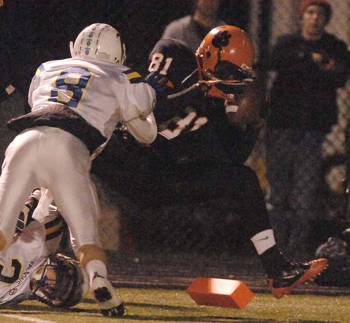 Mike Caponi,left, of Wheaton North tries to stop Titus Davis of Wheaton Warrenville South. This took place during the Wheaton North at Wheaton Warrenville South game Saturday.