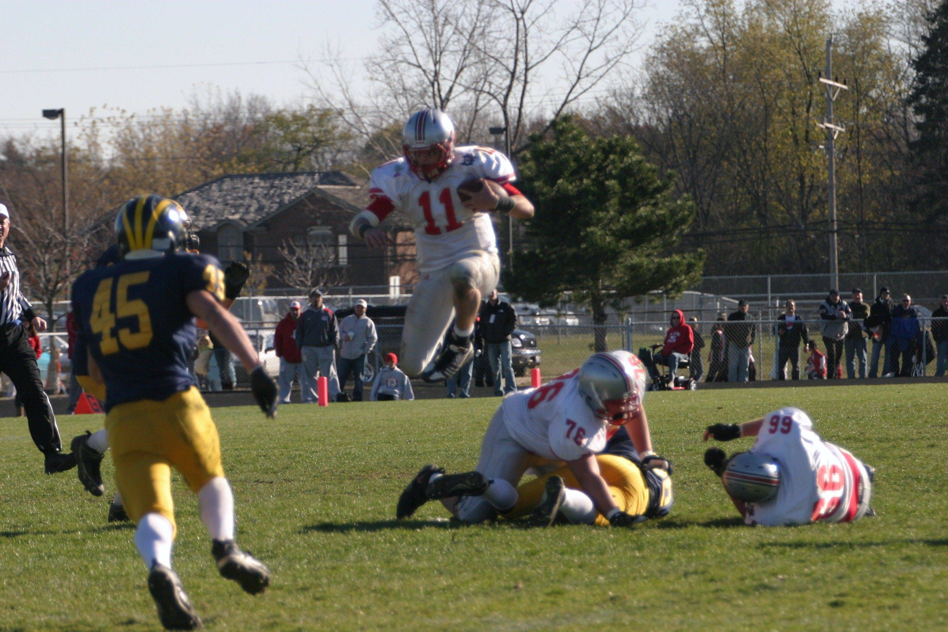 Palatine quarterback Cody Bobbit hurdles a tackler to gain some yards Saturday in Class 8A playoff action at Glenbrook South.