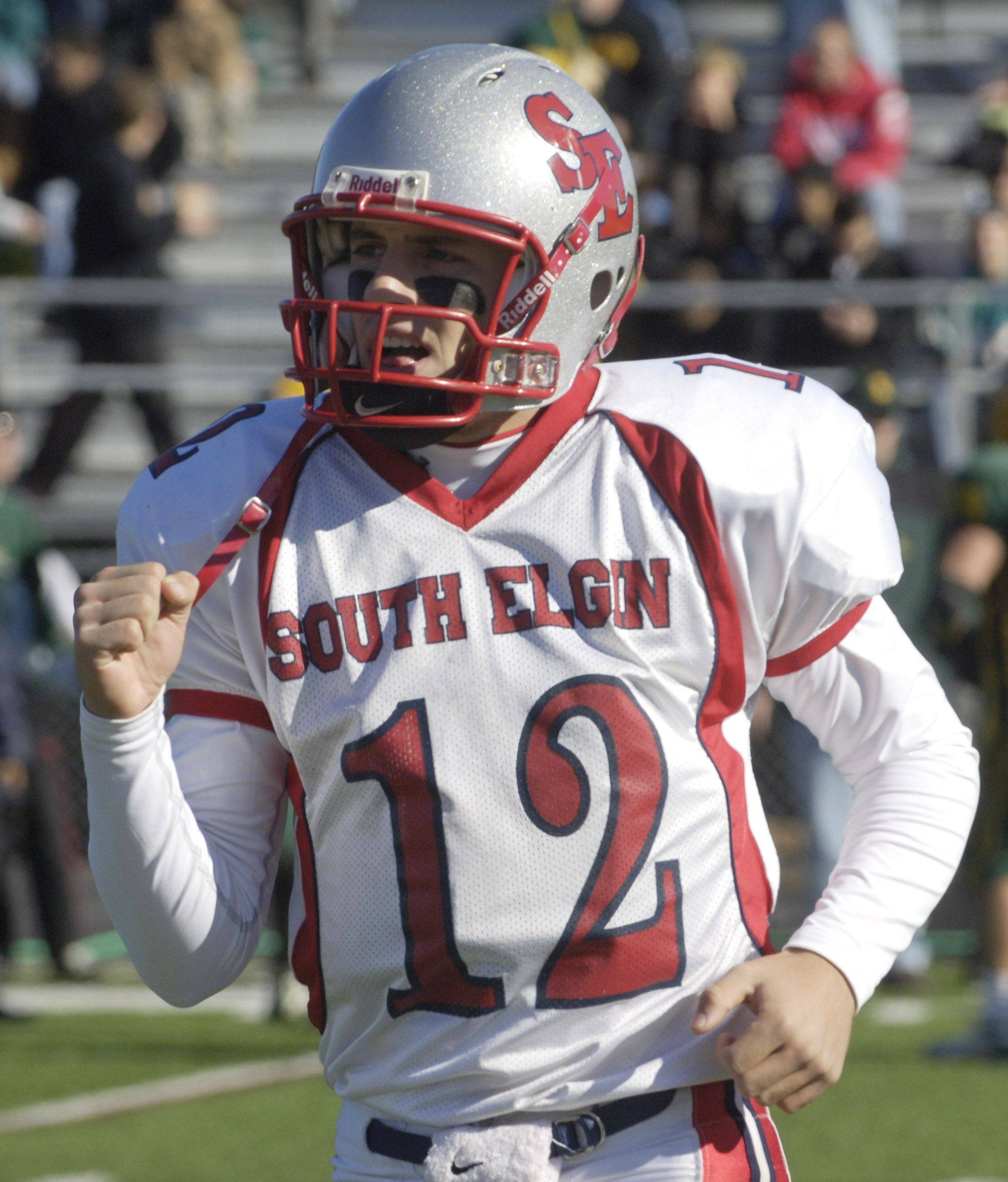 South Elgin quarterback John Menken pumps his fist as he heads back to the sideline after scoring a touchdown against Stevenson Saturday.