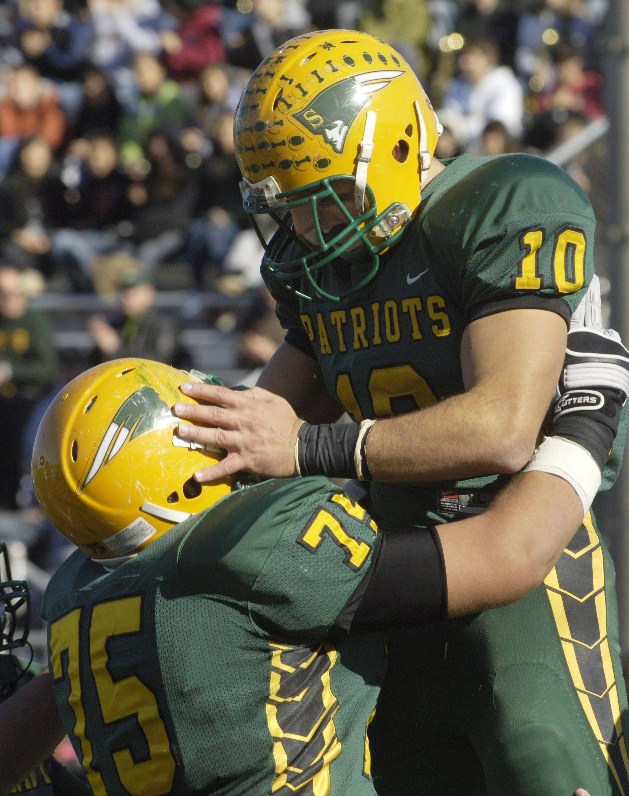 Stevenson's Joseph Cassata, right, celebrates his first quarter touchdown with teammate Jake Hurcombe during Saturday's game against South Elgin.