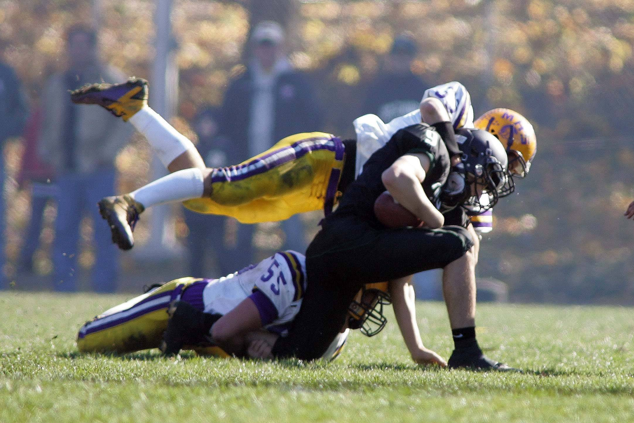 St. Edward quarterback Ben Lehman, 9, is brought down during Mendota at St. Edward Class 4A playoff football in Elgin Saturday, November 6, 2010. 9