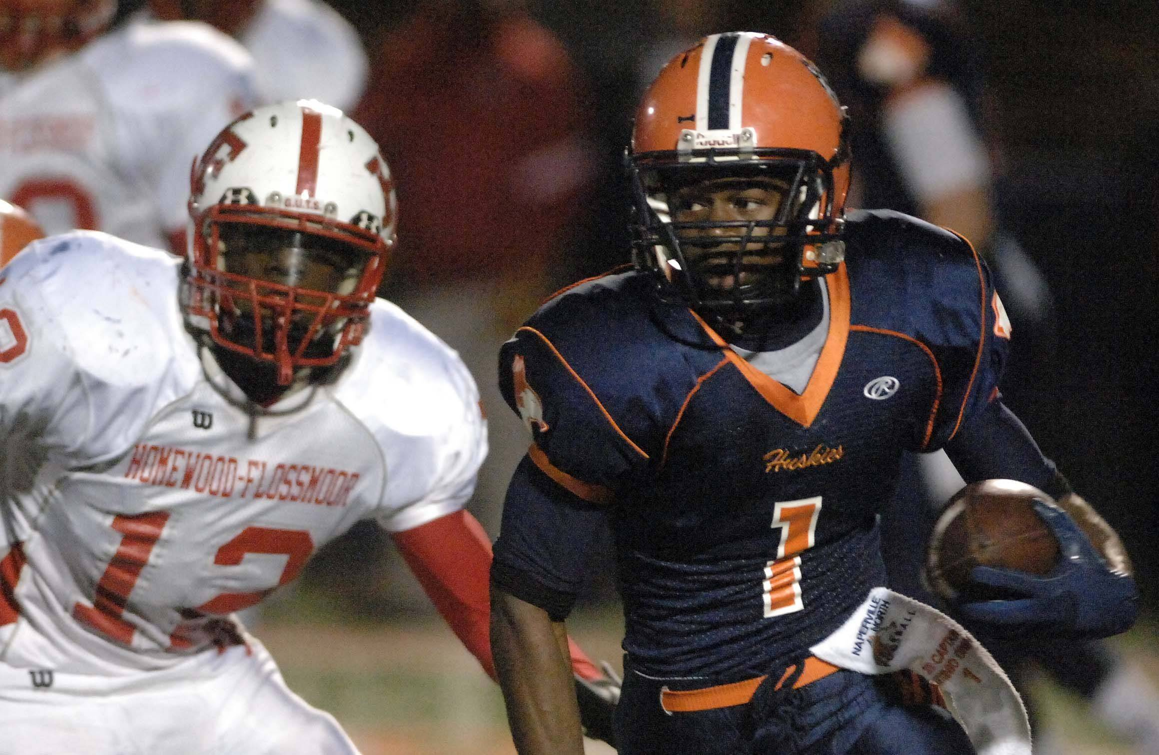Eric Lewis of Homewood-Flossmoor chases down Antonio Owens of Naperville North .