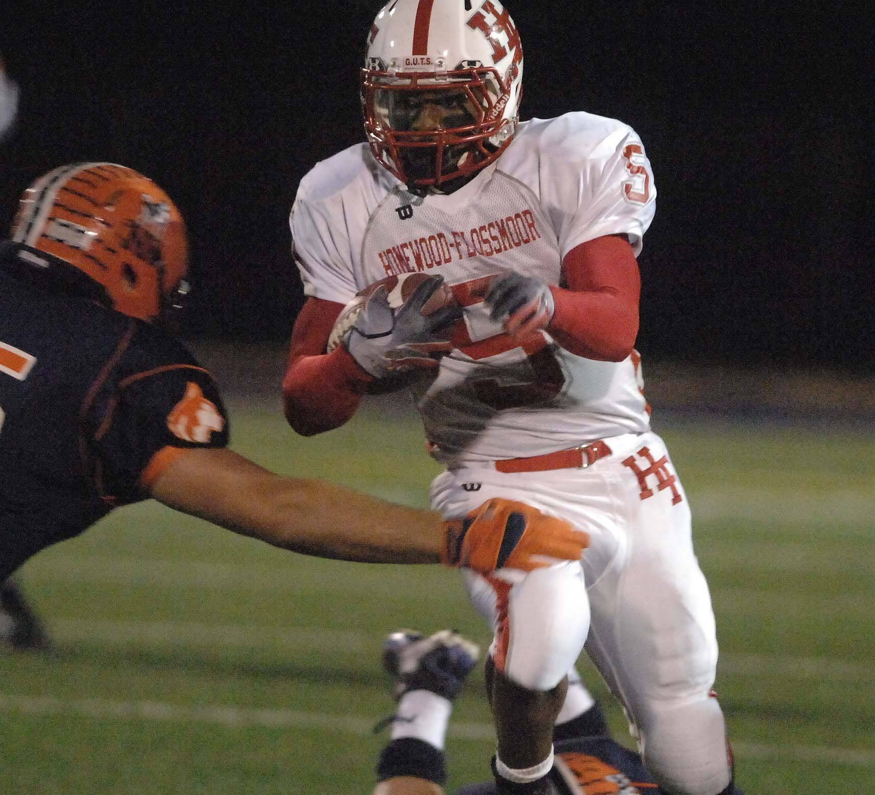 Malik Norman of Homewood-Flossmoor runs the ball .