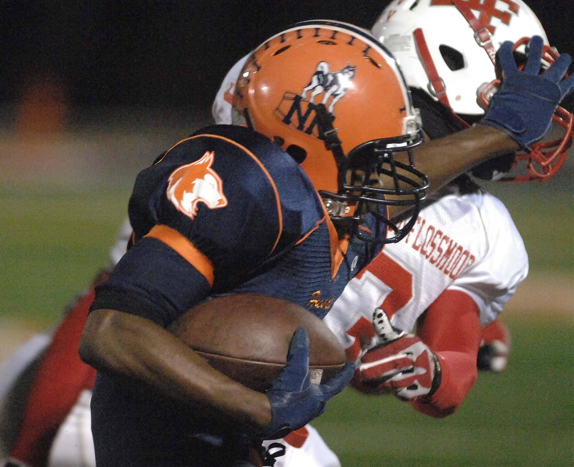 Tarrell Tucker of Homewood-Flossmoor is pushed out of the way by Antonio Owens of Naperville North .