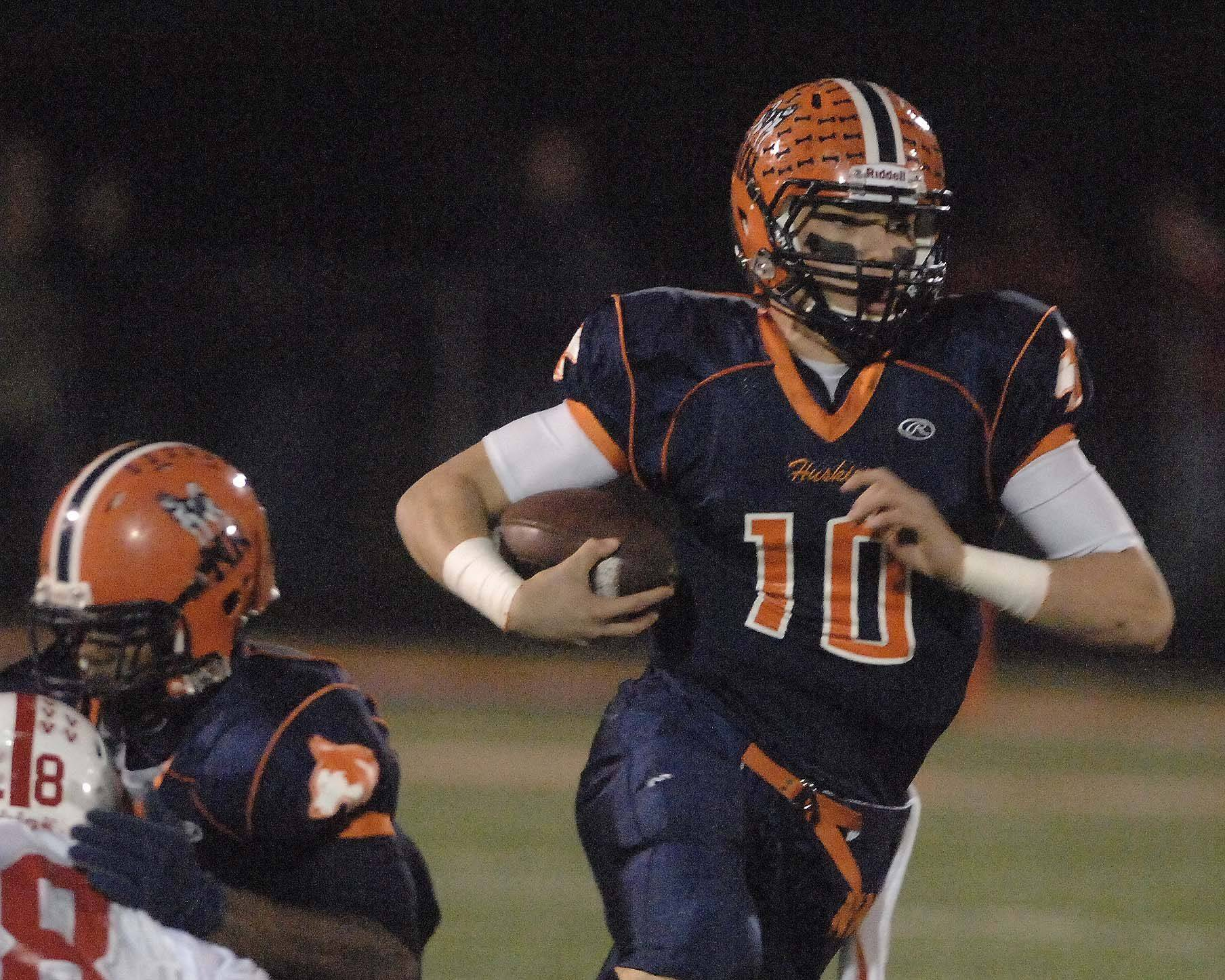 Matt Lacosse of Naperville North runs the ball.