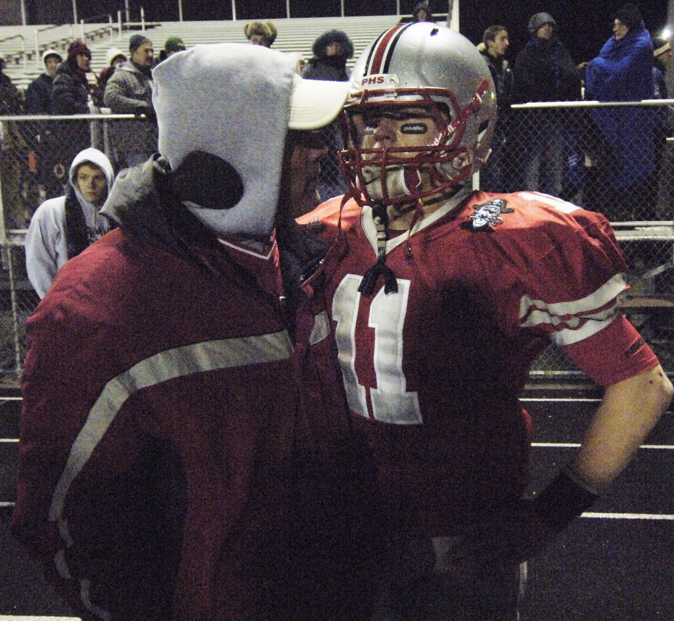 Palatine quarterback Cody Bobbit has a talk with his dad, Kevin, following Saturday night's loss to Loyola Academy.