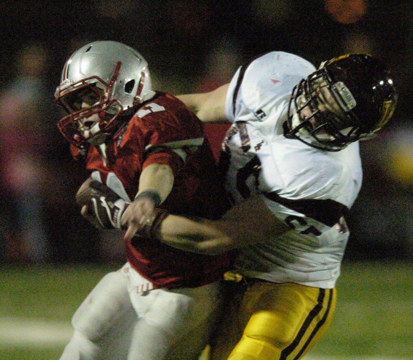 Palatine's Cody Bobbit gets tackled by Loyola Academy's Mark Sullivan.