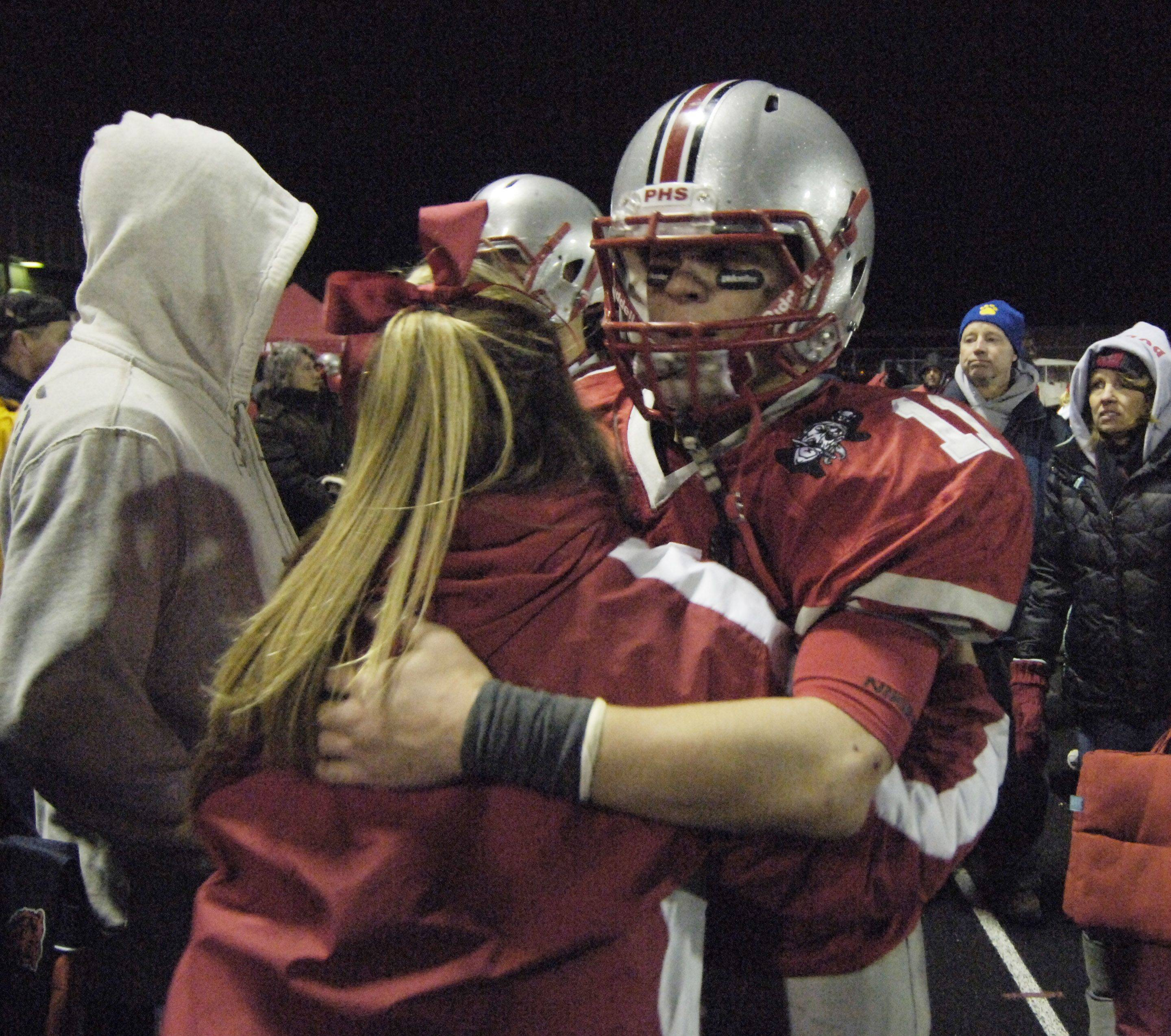 Palatine fans line up to hug Palatine quarterback Cody Bobbit following Saturday night's loss to Loyola Academy.