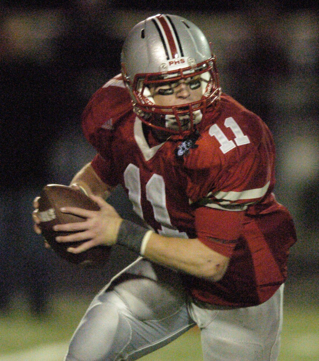 Palatine quarterback Cody Bobbit carries the ball against Loyola Academy.