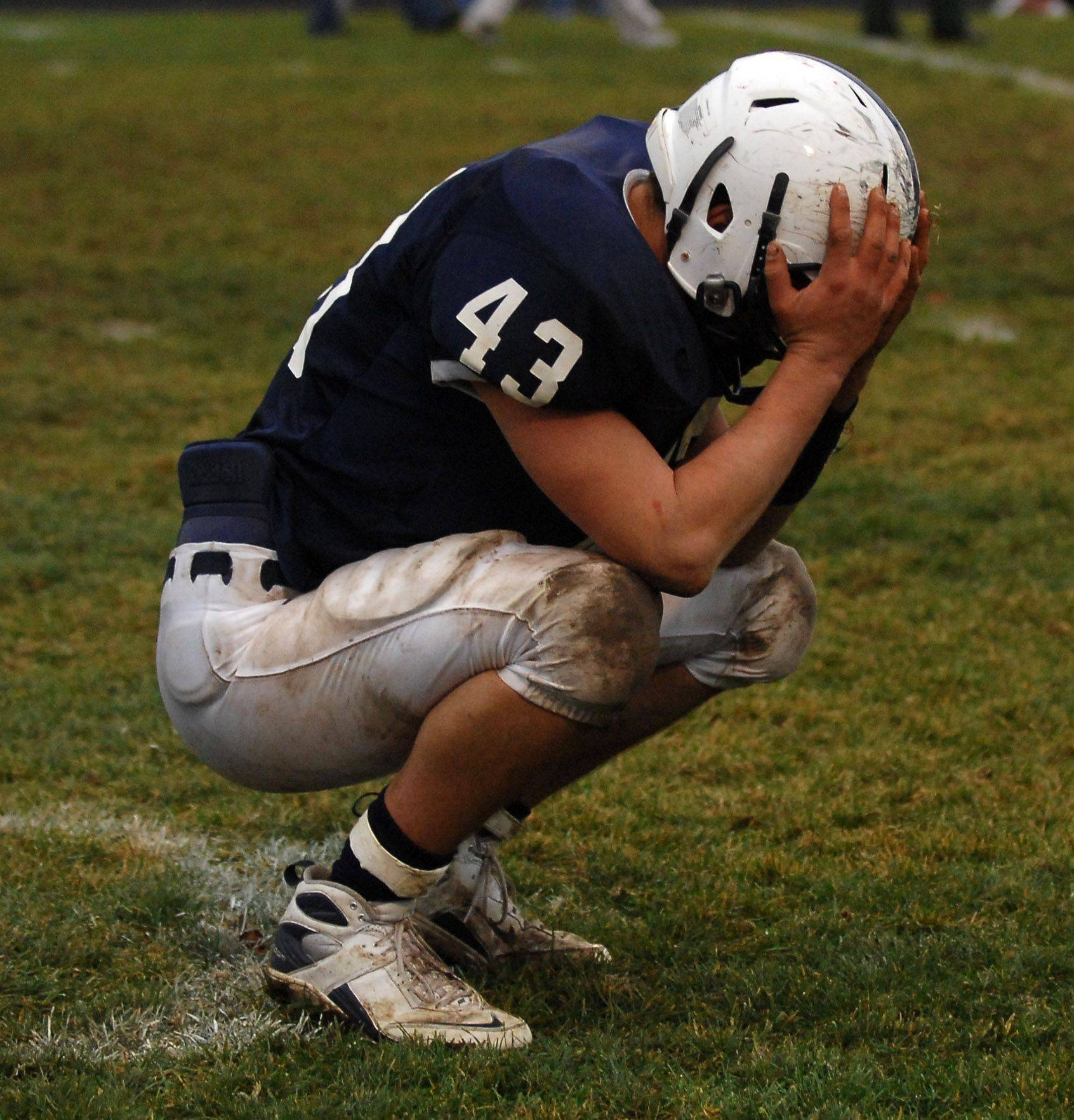 Cary-Grove's Cole Connington reacts to the Trojans overtime loss to Rockford Boylan during Saturday's playoff game in Cary.