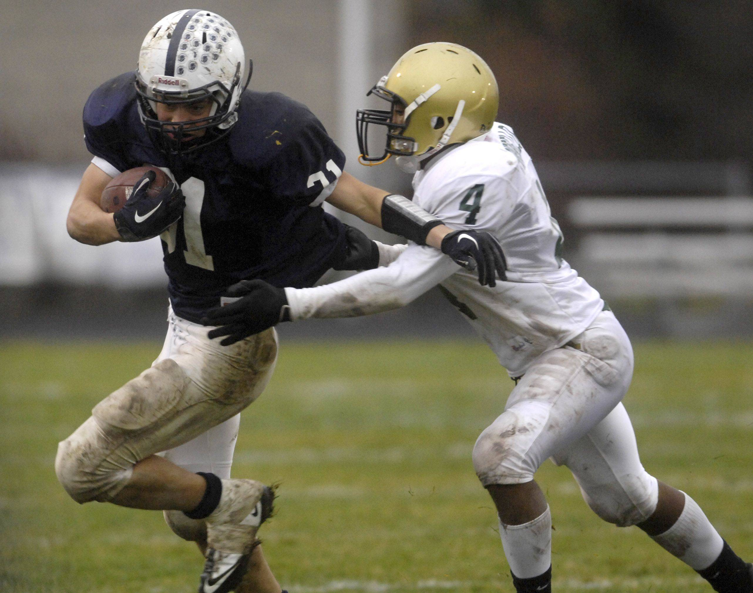 Cary-Grove's Ryan Mahoney breaks free from Rockford Boylan's Tony Pirello during Saturday's playoff game in Cary.