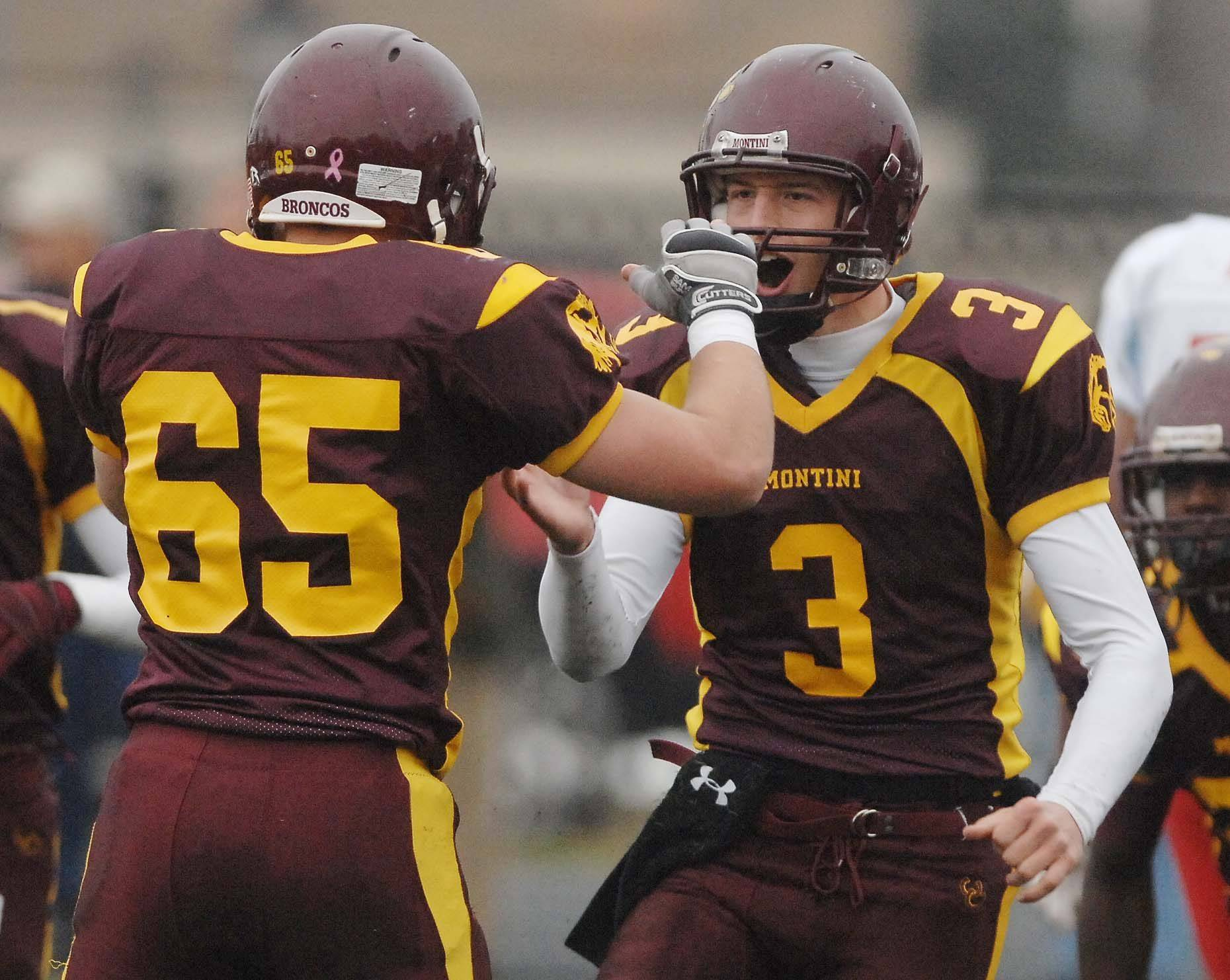 Montini's Brian Piper, left, and Matt Westerkamp celebrate as they take the lead against Marian Central in Elmhurst Saturday.