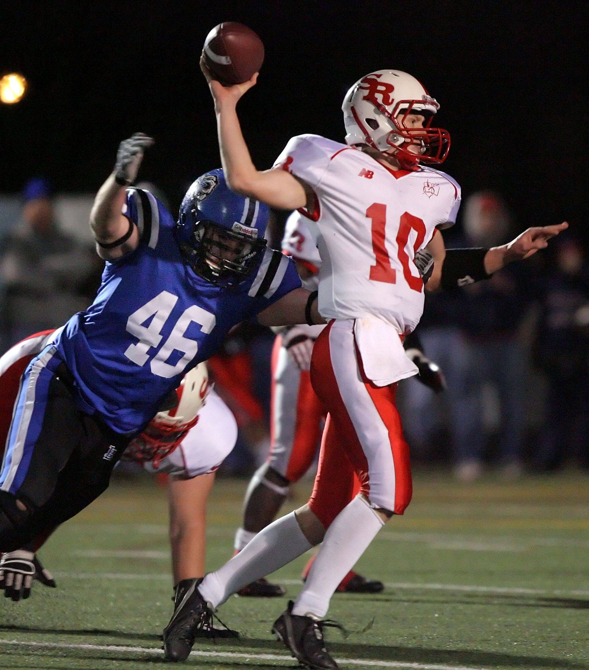 Lake Zurich's Mark Tabaka bears down on St. Rita's Brandon Johnson 21-0 during the IHSA Class 7A football semi final game Saturday night at Lake Zurich High School.