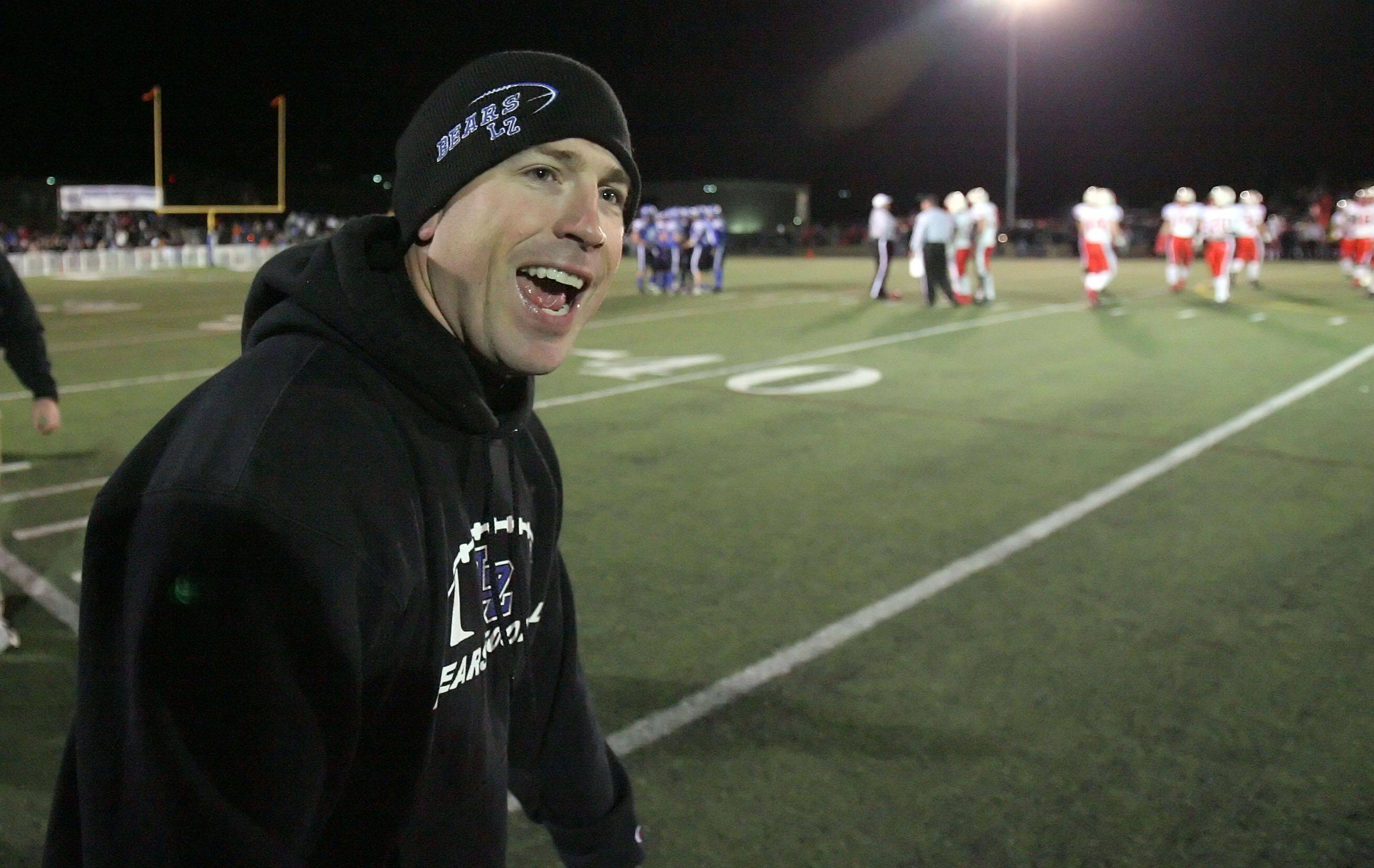 Lake Zurich Head Coach Bryan Stortz celebrates after beating St. Rita 21-0 during the IHSA Class 7A football semi final game Saturday night at Lake Zurich High School.