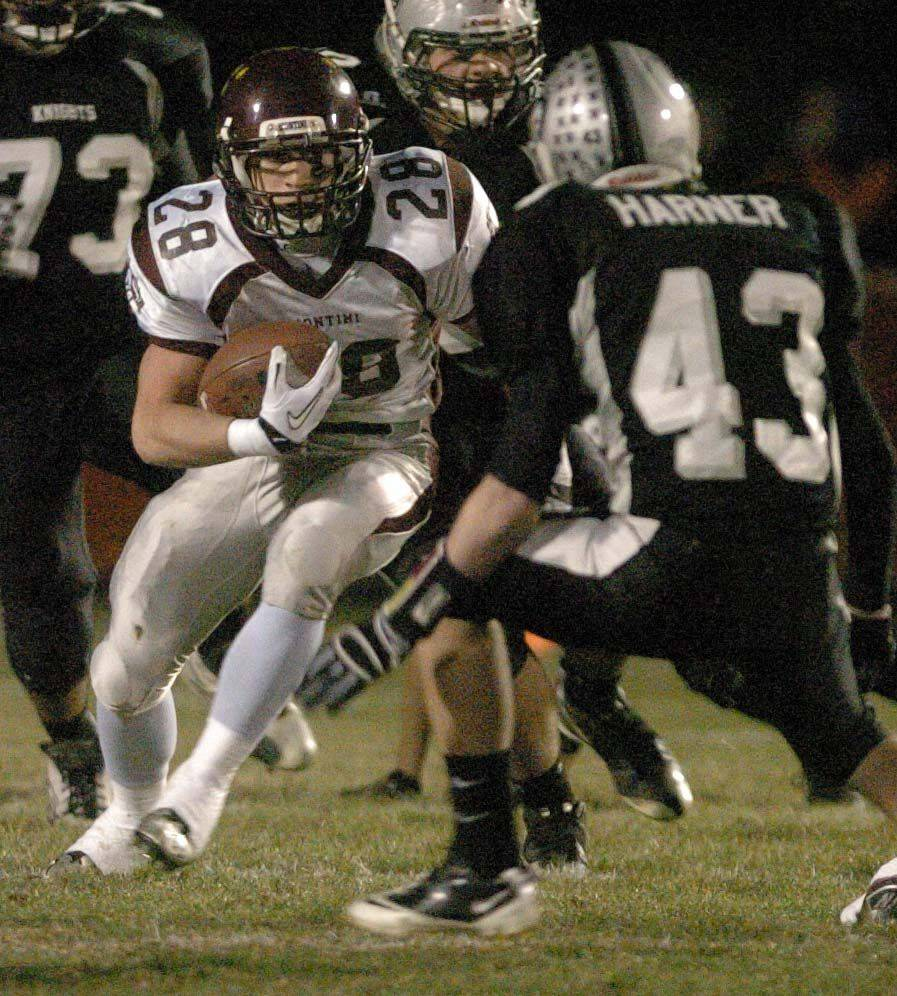 Frank Baer of Montini moves the ball through the Kaneland defence during game action Saturday.