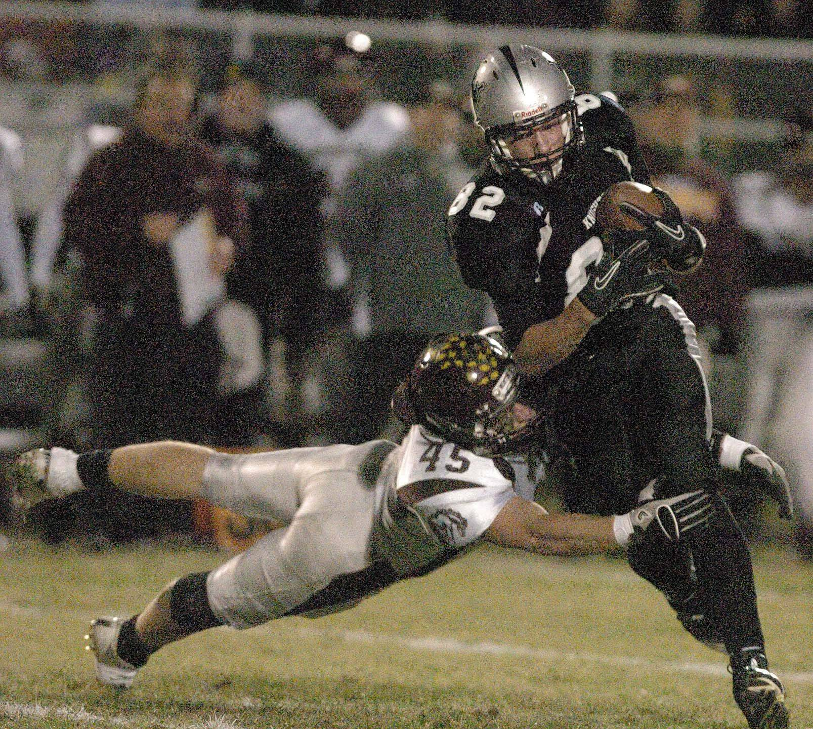 Alex Walters of Montini pulls down Daniel Helm of Kaneland during game action Saturday.
