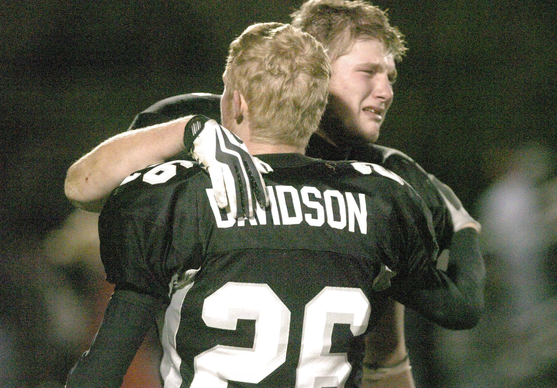 Blake Serpa gets a hug from Kyle Davidson after their loss to Montini Saturday.
