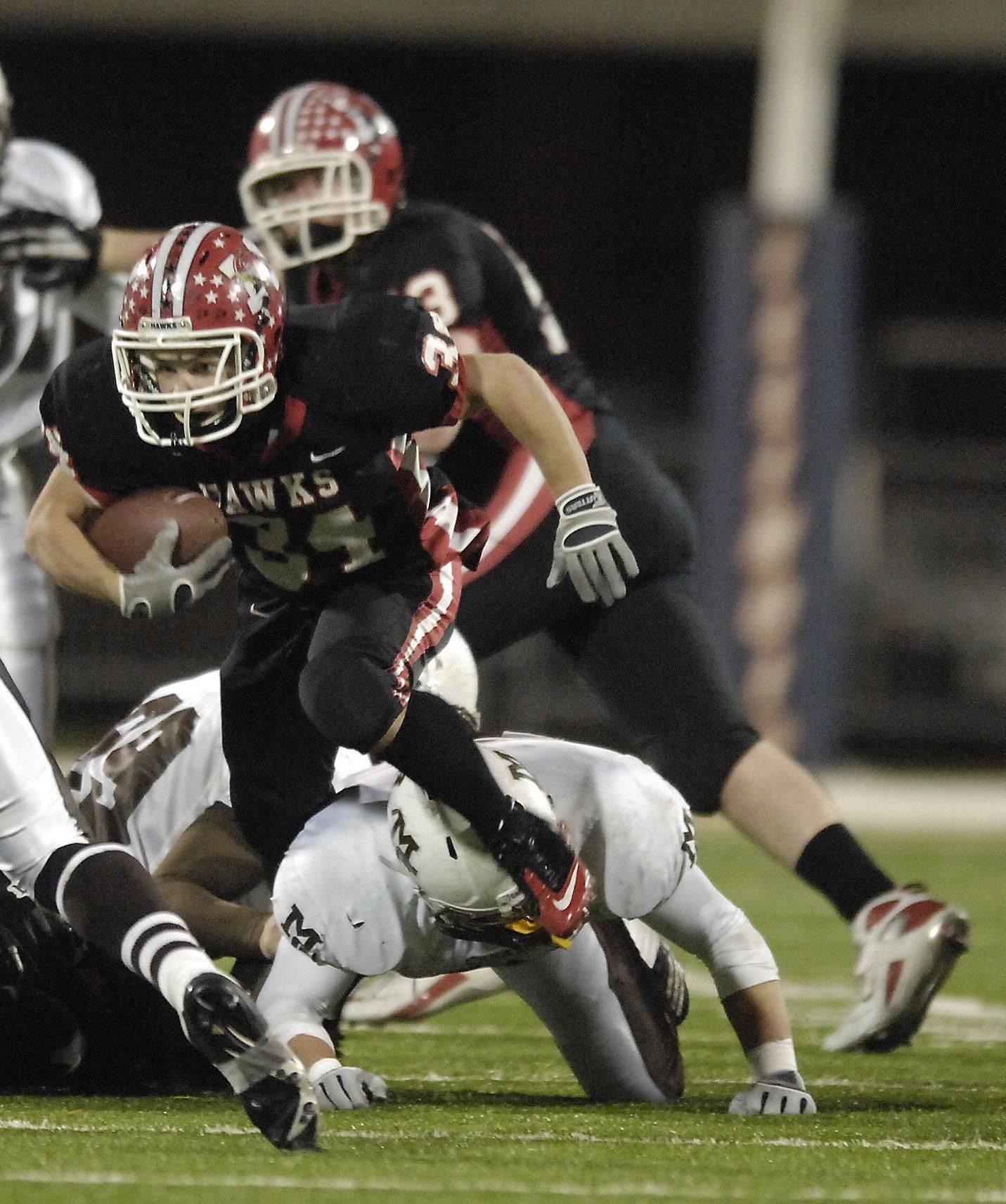 Maine South's Paul Preston runs over a Mt. Carmel defender during the Class 8A state final in Champaign Saturday.