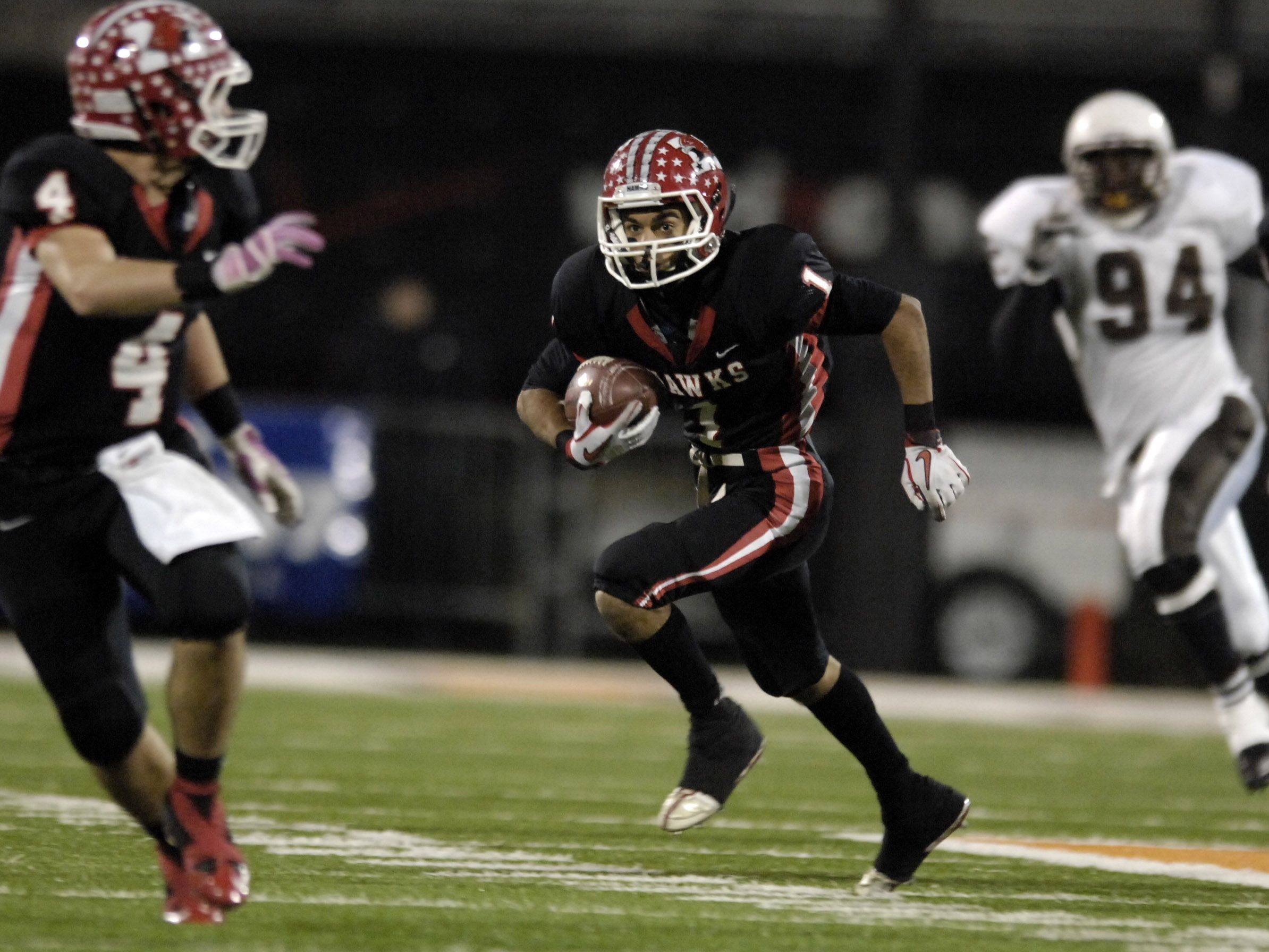 Maine South Imran Khan turns a short catch into a long touchdown run against Mt. Carmel during the Class 8A state final in Champaign Saturday.