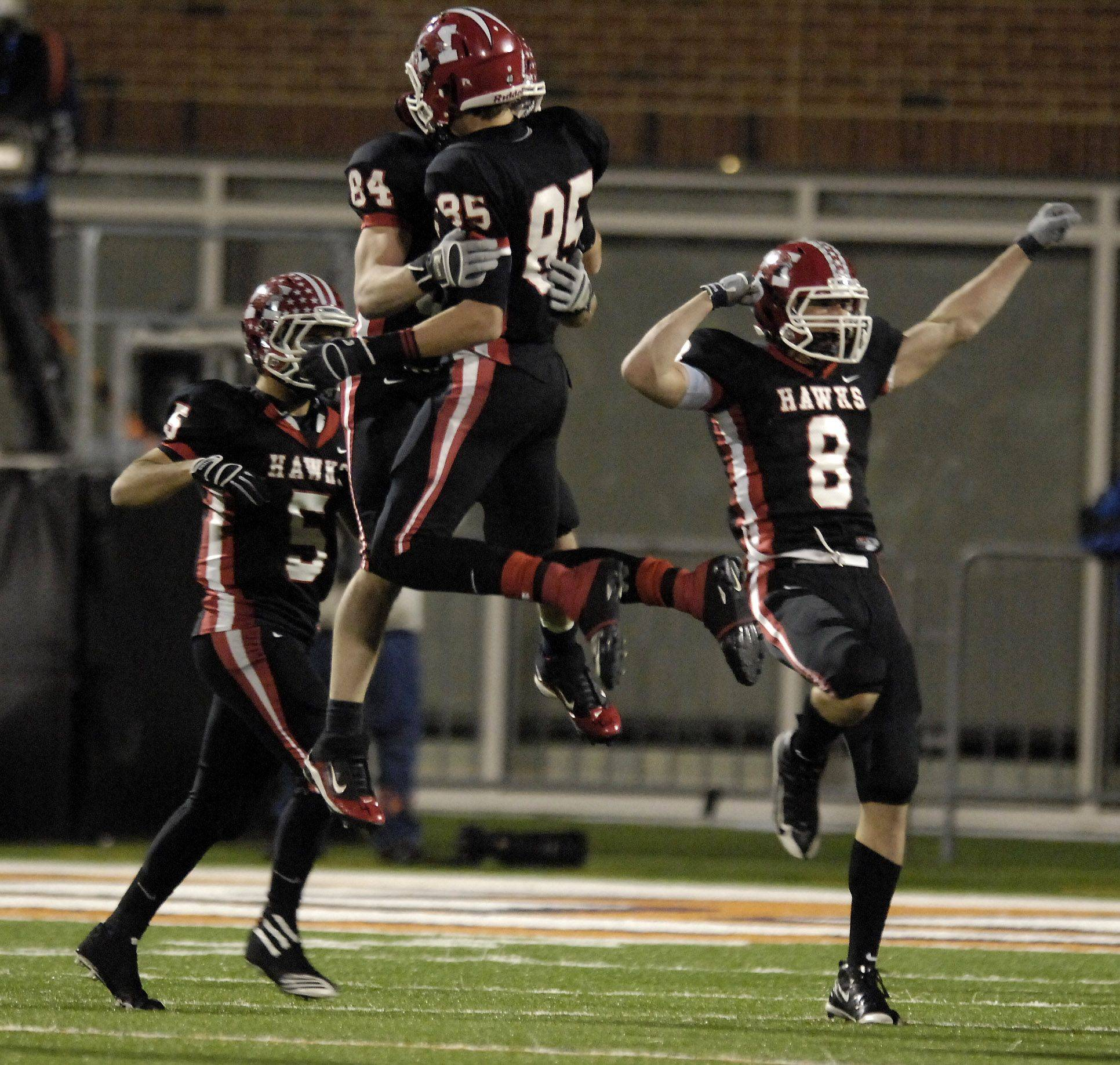 The Maine South defense, including (from left) John Fabiano, Andrew Hjellming, Cody Horodnik, and Patrick Swiszcz celebrate after stopping Mt. Carmel on a fourth and goal in the third quarter during the Class 8A state final in Champaign Saturday.