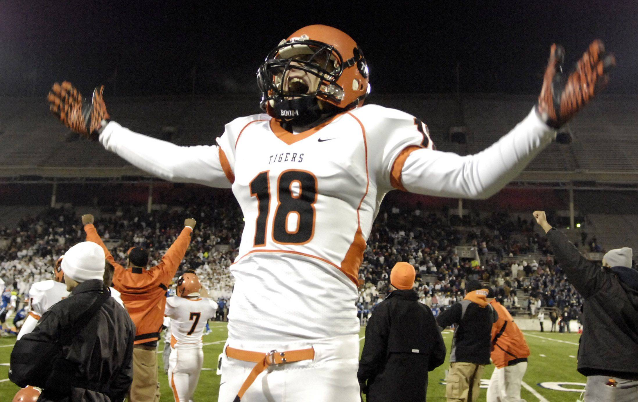 Wheaton Warrenville South's Joe Sullivan celebrates the Tigers final touchdown against Lake Zurich during the Class 7A state final in Champaign Saturday.