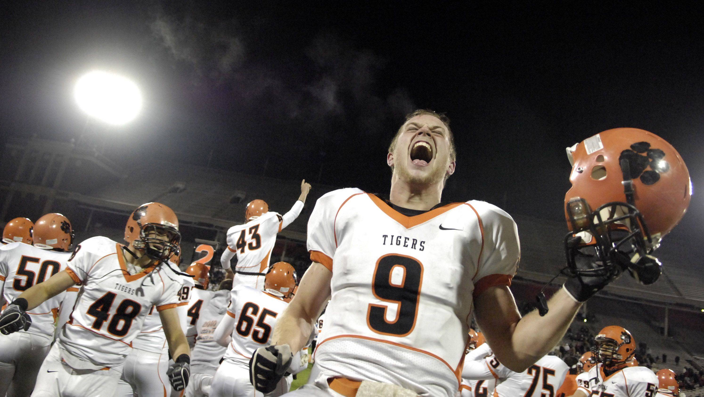 Wheaton Warrenville South's Matt Rogers and his teammates celebrate as the final seconds tick off the clock in their win over Lake Zurich during the Class 7A state final in Champaign Saturday.
