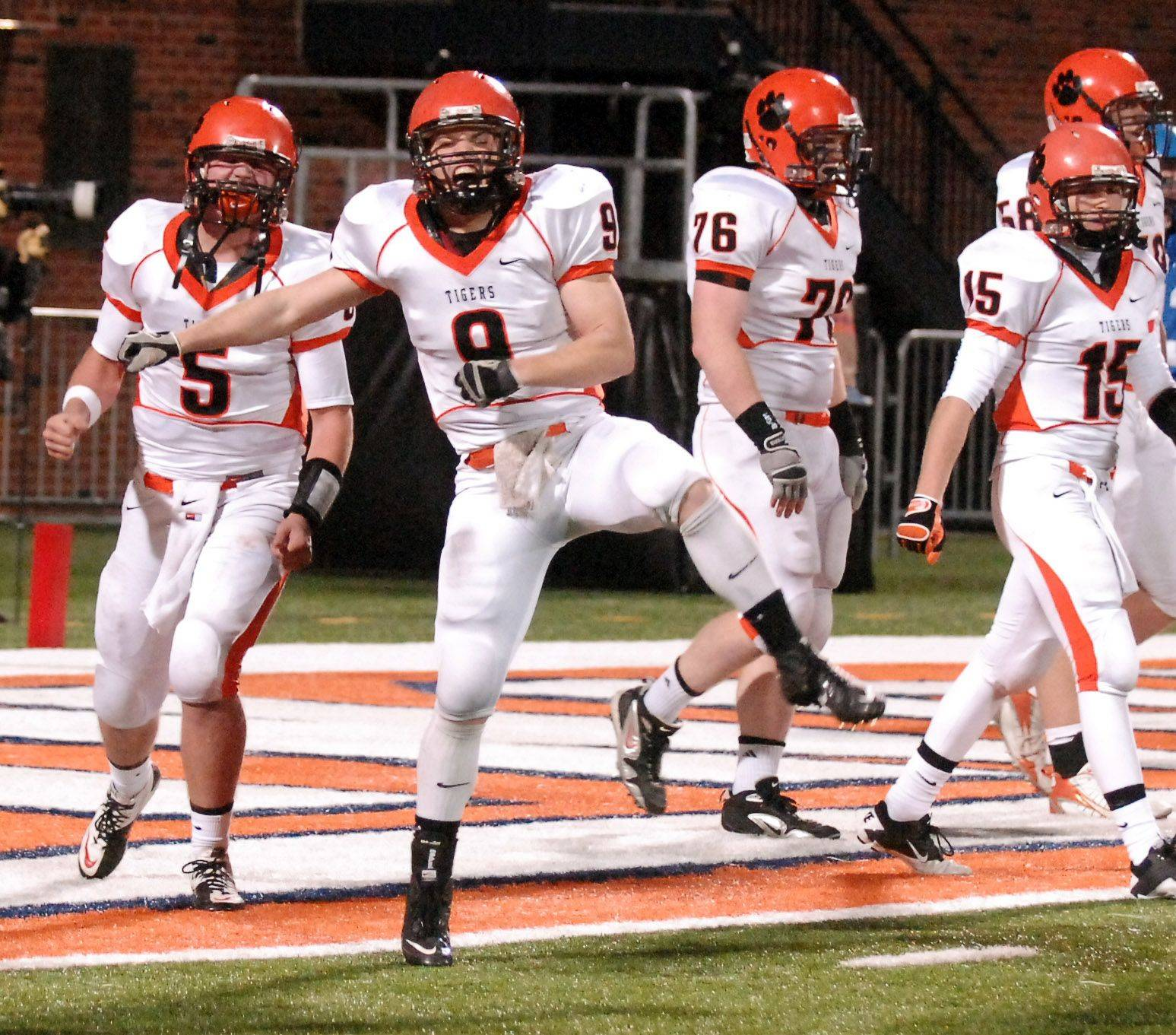 Wheaton Warrenville South's Matt Rogers celebrates his game-clinching touchdown against Lake Zurich during the Class 7A state final in Champaign Saturday.