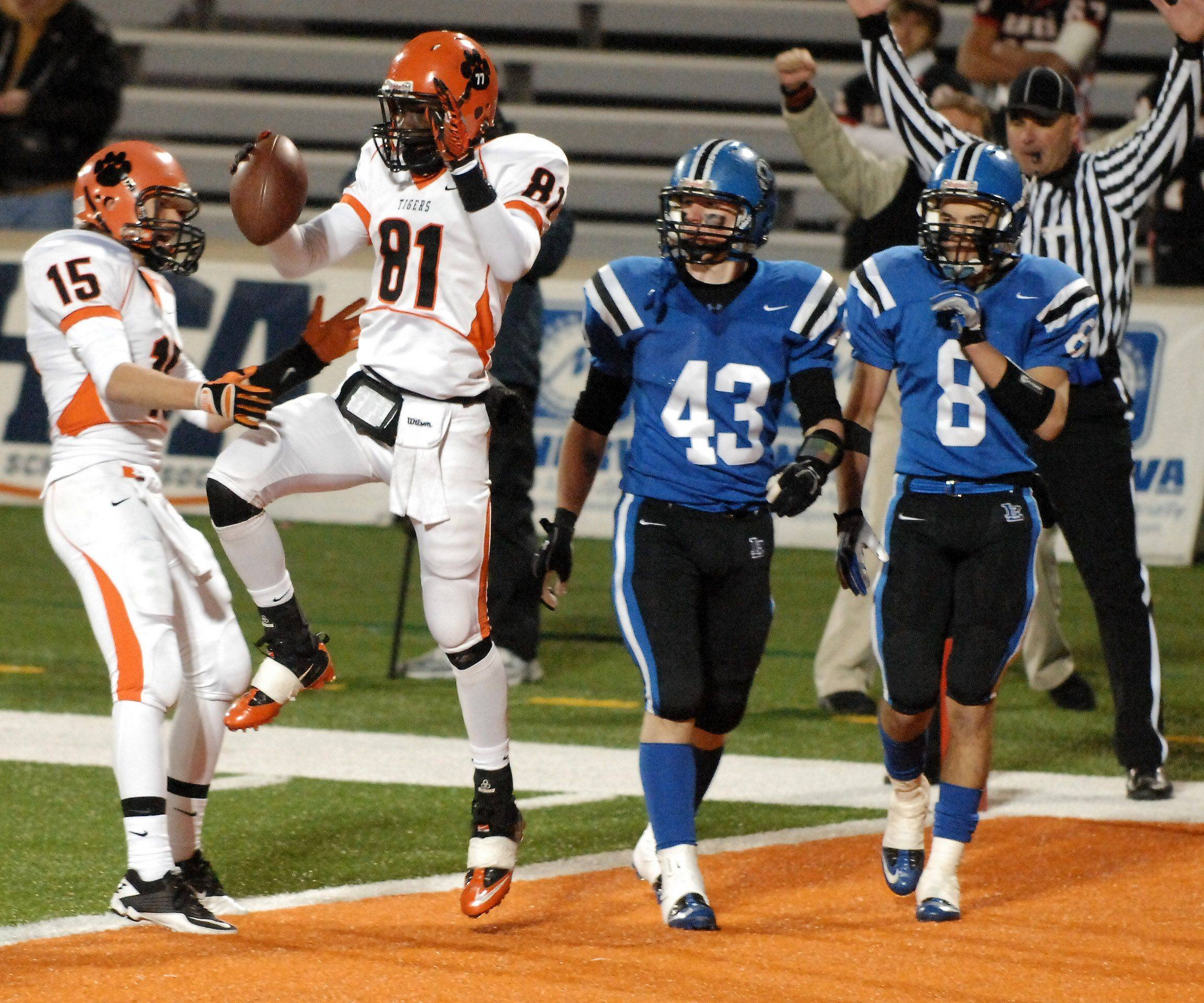 Wheaton Warrenville South's Titus Davis celebrates his touchdown catch against Lake Zurich during the Class 7A state final in Champaign Saturday.